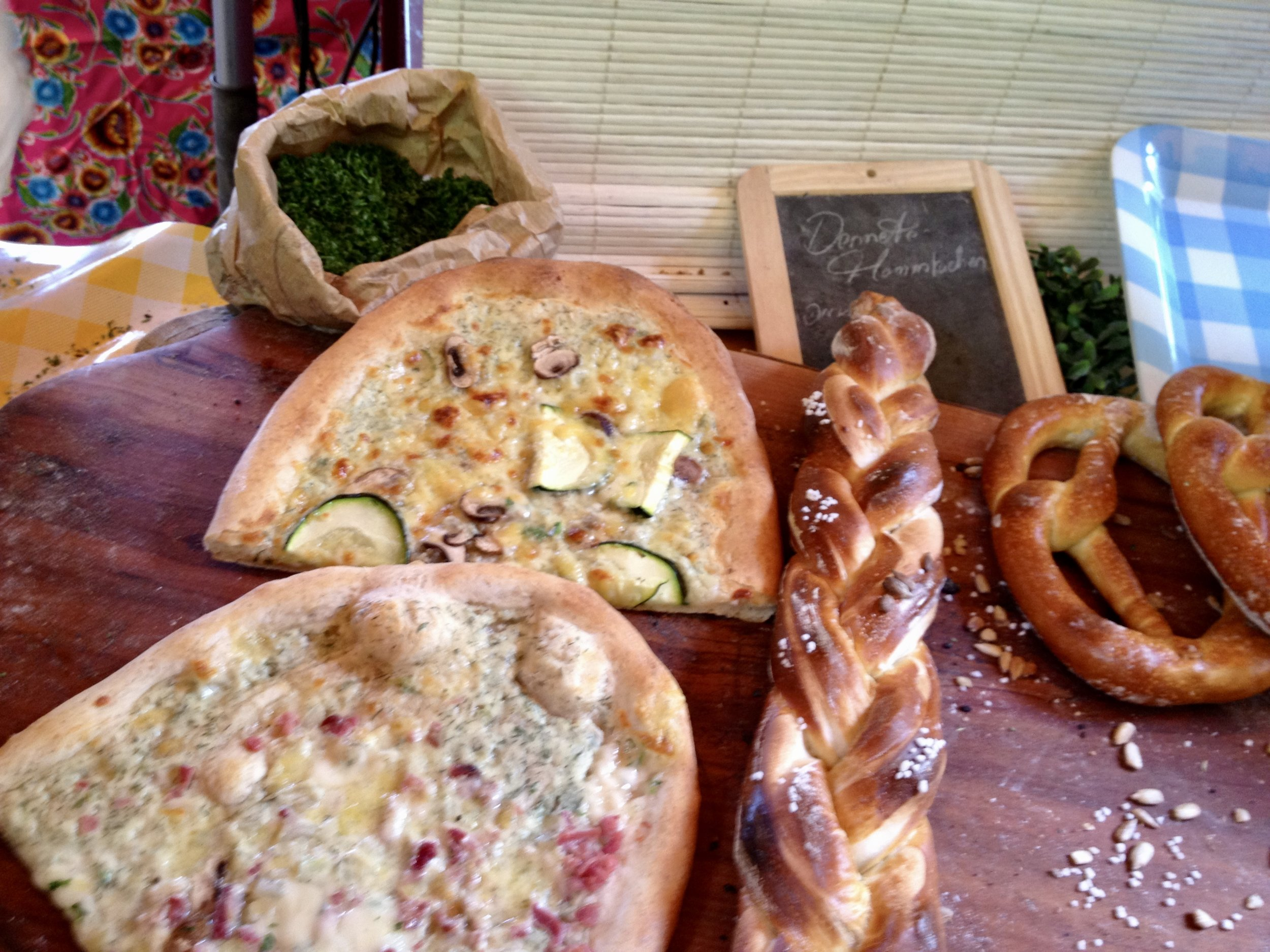 Saturday farmers'market at  Boxhagener Platz . My German friend claims this is not pizza but I disagree.