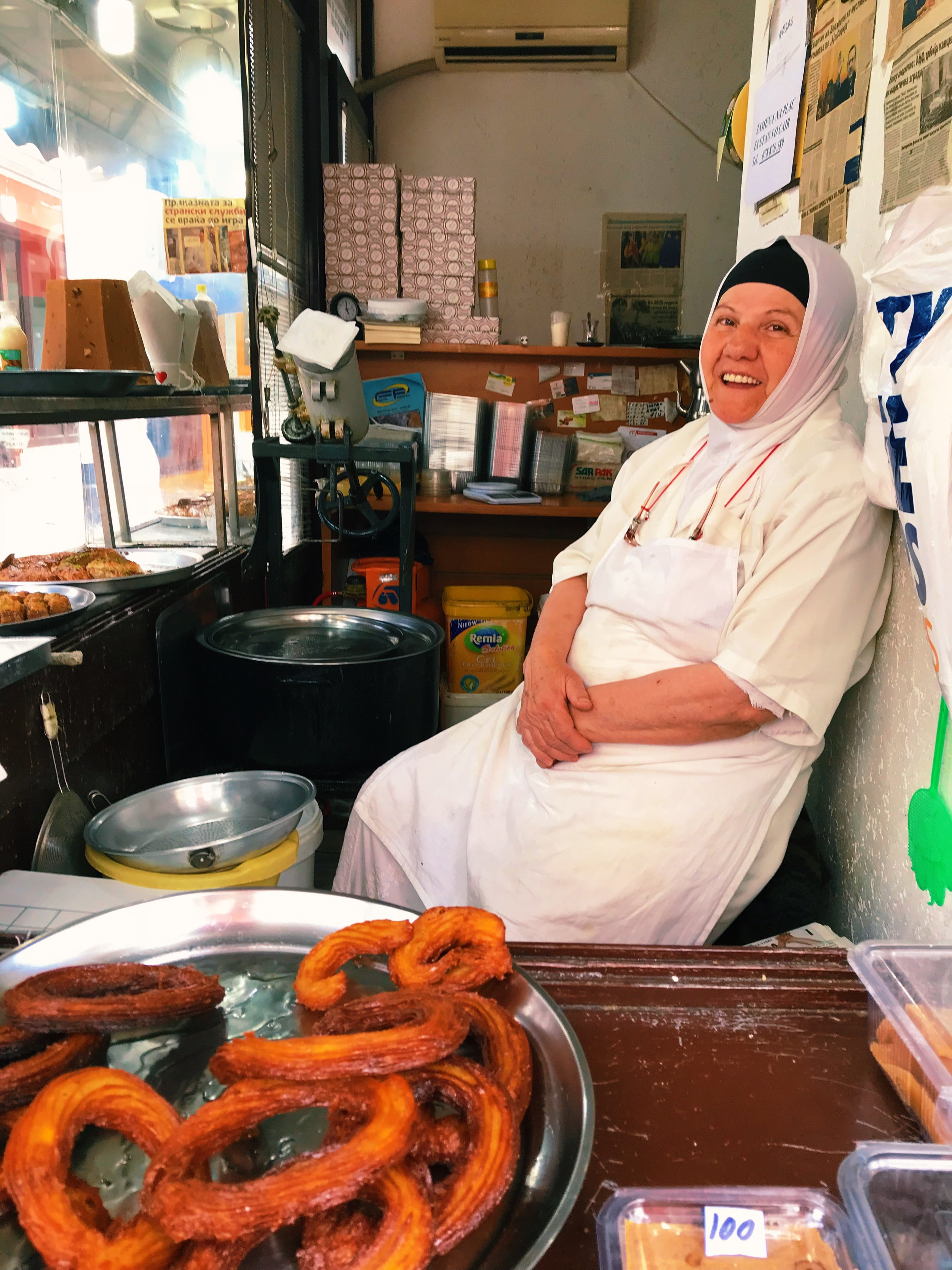 These sweet, fried rings are called tulumba and this lady serves them warm. She married a Turkish man and called this pastry shop Istanbul, serving sweets from Turkey. Interestingly, she's been in the newspapers for her pistachio baklava, which she named after Angela Merkel.