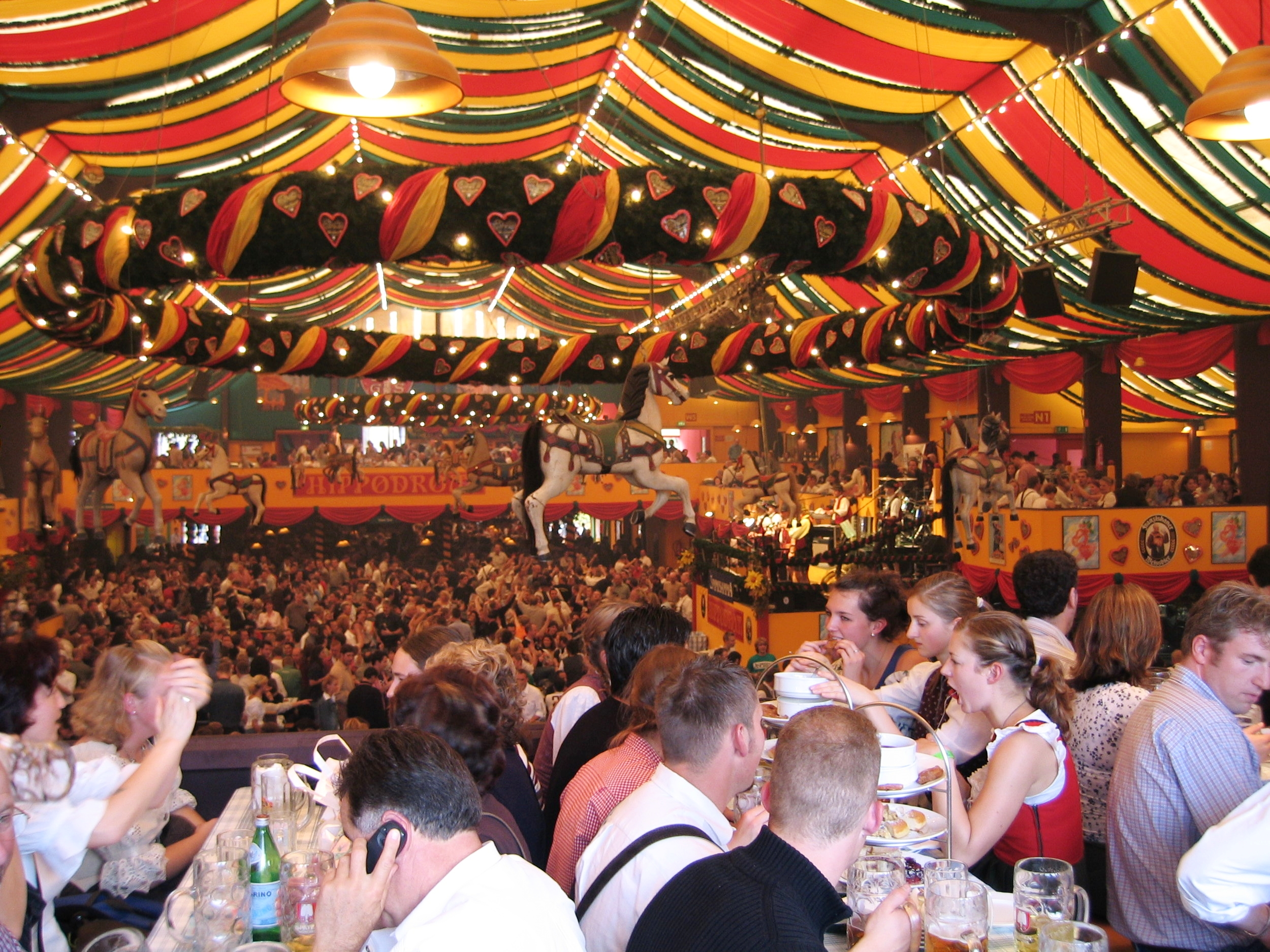Inside the Hippodrom beer tent at Oktoberfest. Isn't it cool/interesting that most people are eating and chatting to each other rather than on phones?