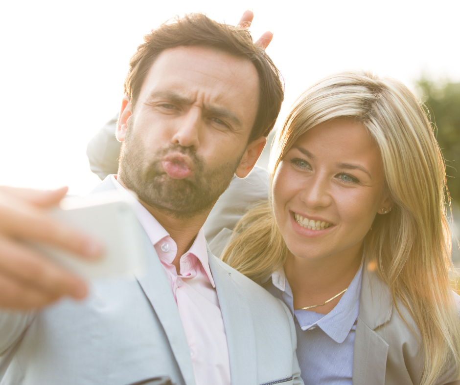 man and woman taking a ridiculous selfie at a wedding for Instagram