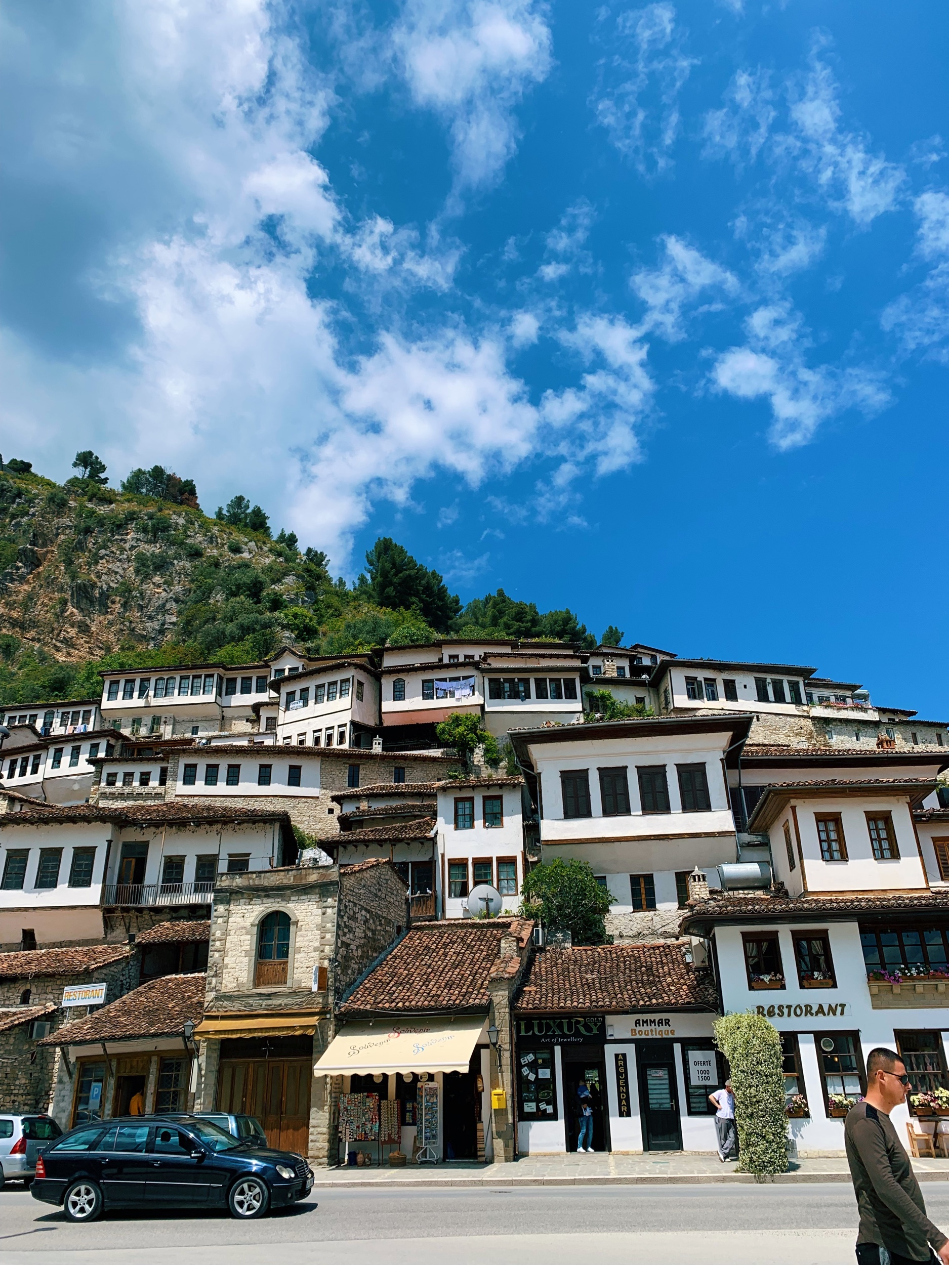 """Berat  . In the past only rich people could have more than one window, but in Berat, they said, """"Hey, we like the sun. We're adding more windows."""""""