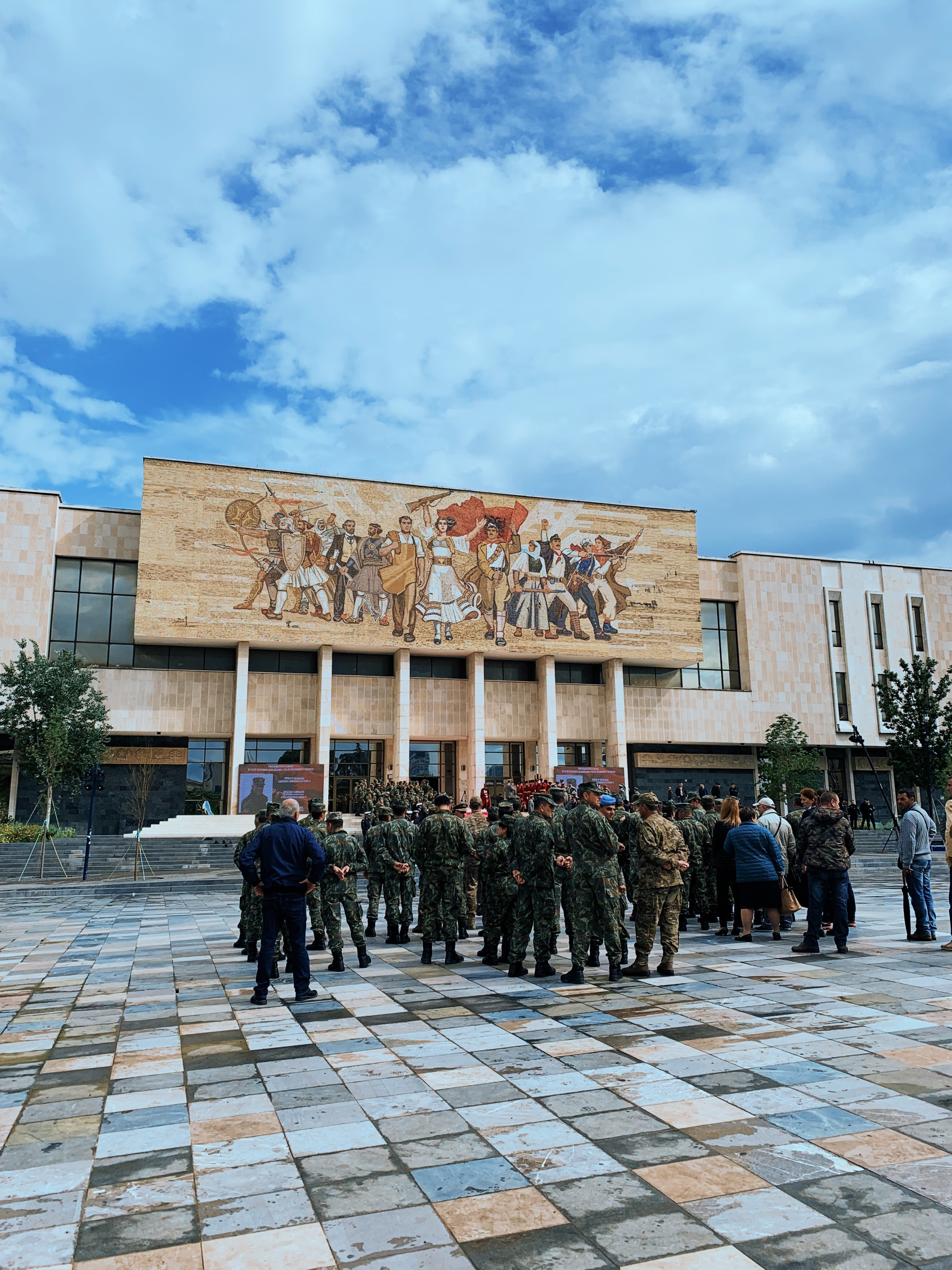Skanderbeg Square, the center of town. Military men gather for a commemoration of some kind in front of the  National Museum of History .