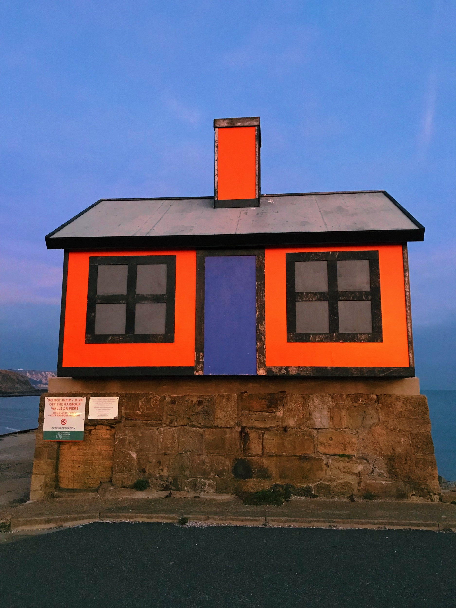 """Richard Woods' Holiday Home. """"Many people have two homes whilst many others can't afford one.  Holiday Home  (six one-third size 'homes' identical except in their colourways) is in 'unlikely' places – suggesting that no site is too small, too unlikely, or too inconvenient for its neighbours, for a holiday home."""" —  Creative Folkestone"""