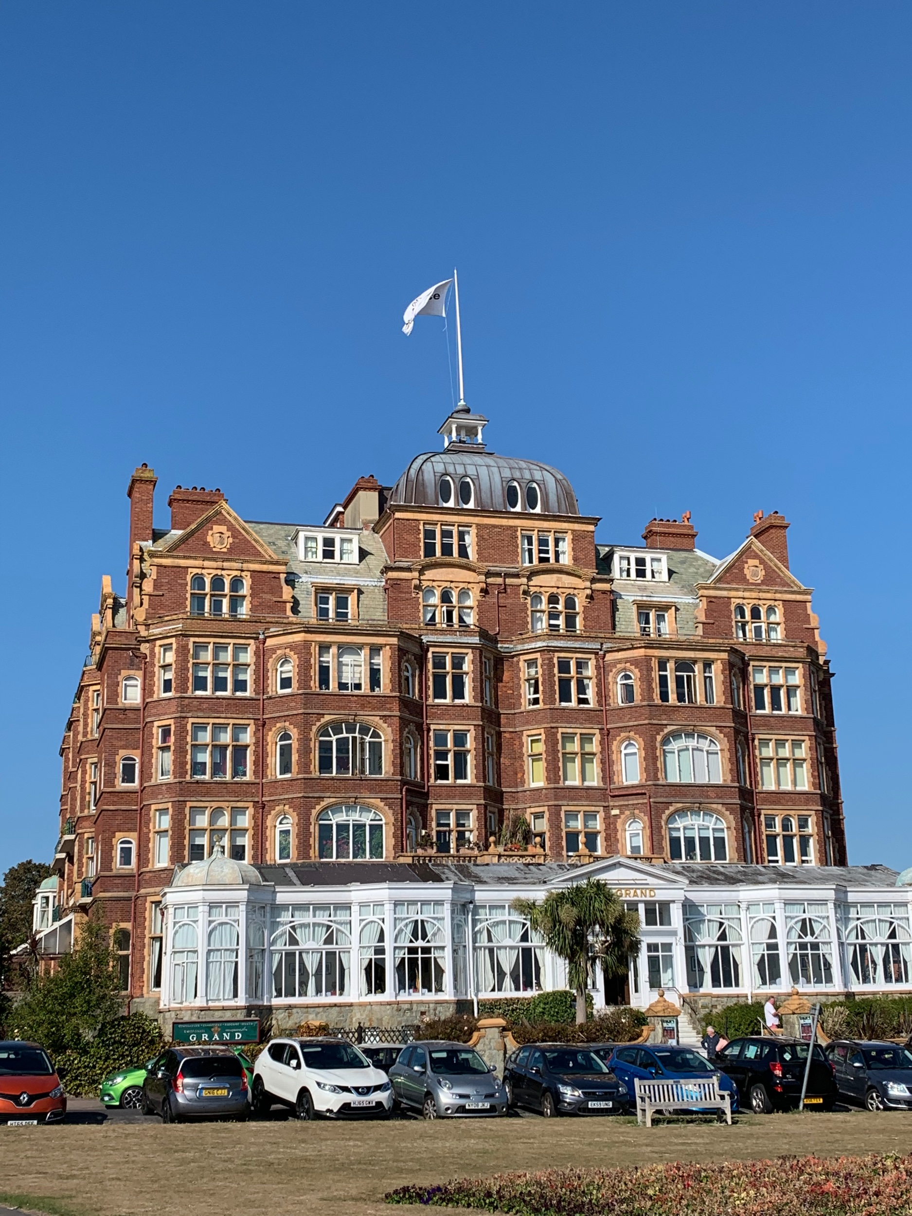 The Grand hotel . Folkestone was really rocking in Victorian times. King Edward 7th used to stay here with his mistress Alice Keppel, and sometimes the queen, as well. You can still rent a room and/or dine here and they offer tours on Fridays.  At the very top, a light blinks 'Earth Peace' in Morse code. This is an art installation by Yoko Ono.