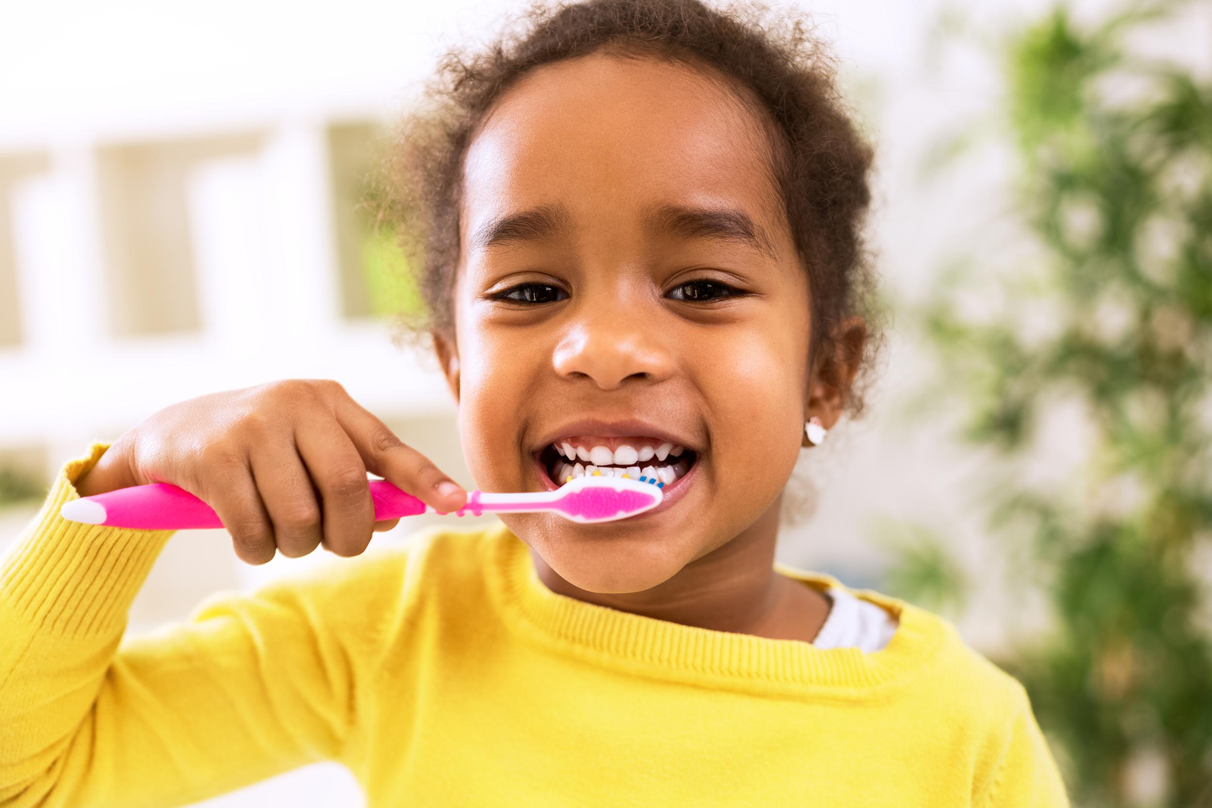 liquid-fillings-girl-brushing-teeth-pediatric-dentistry.png