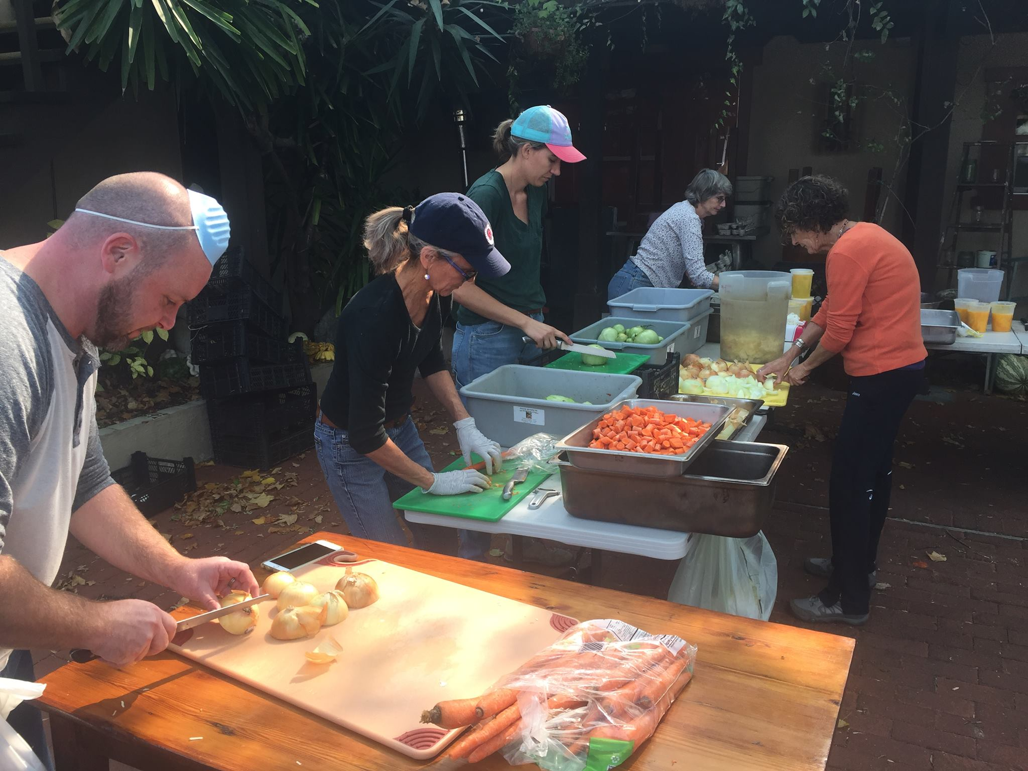 Volunteer cooks prepping the generously donated produce at Backyard Restaurant.