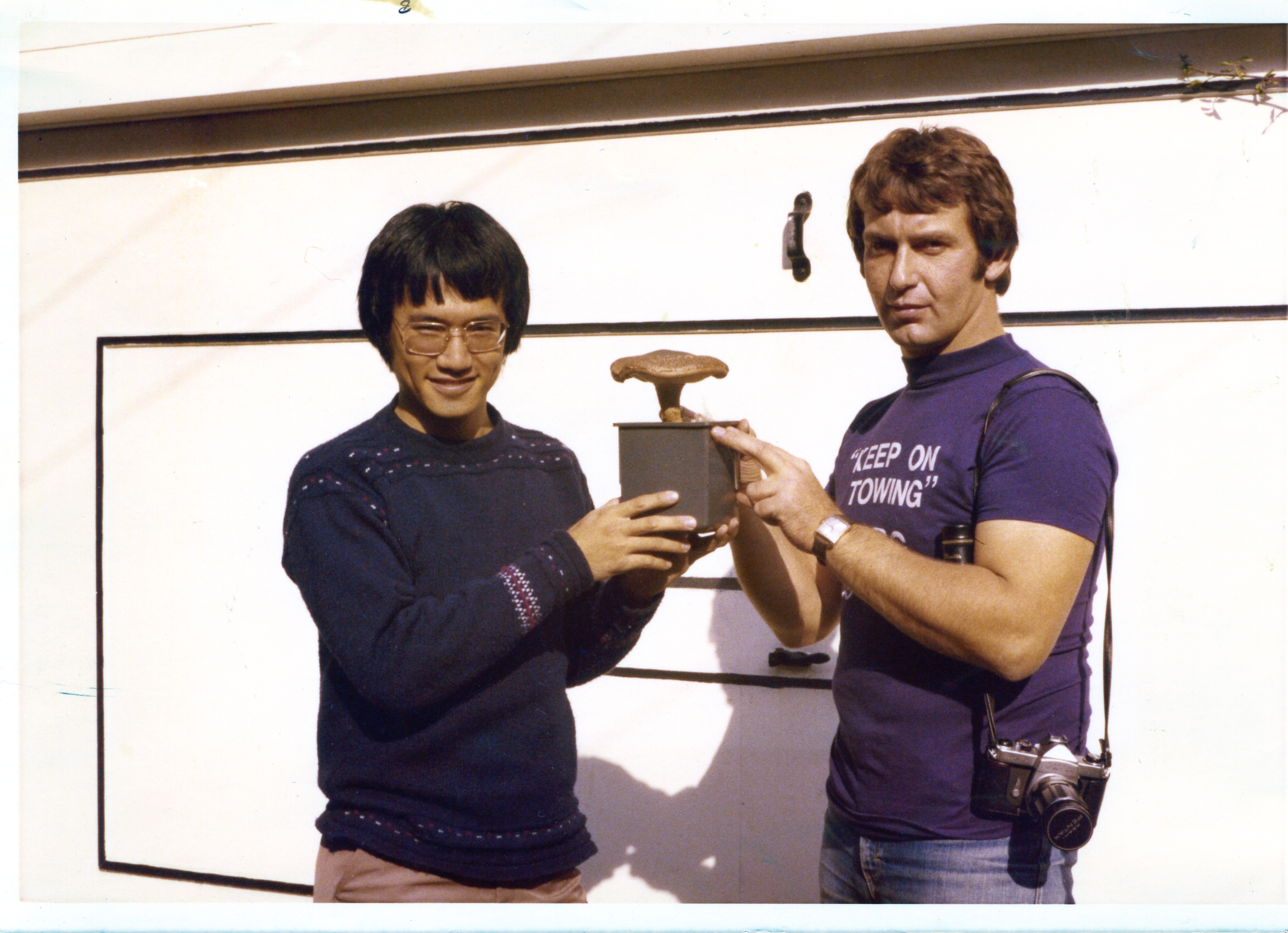 Keep on Towing: Co-founders David Law and Malcolm Clark with their first successfully cultivated shiitake mushroom in 1977