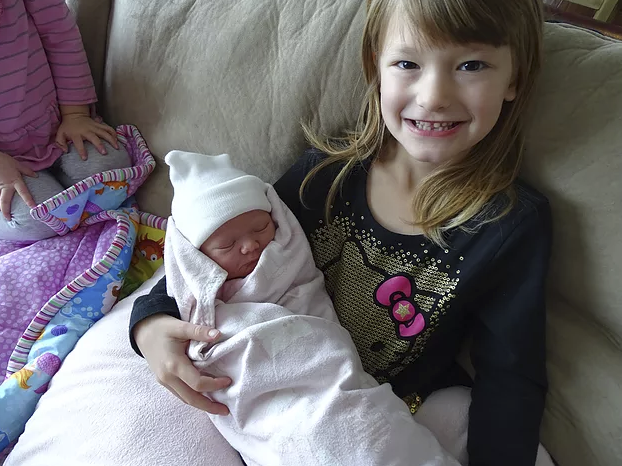 My daughter with her new cousin!