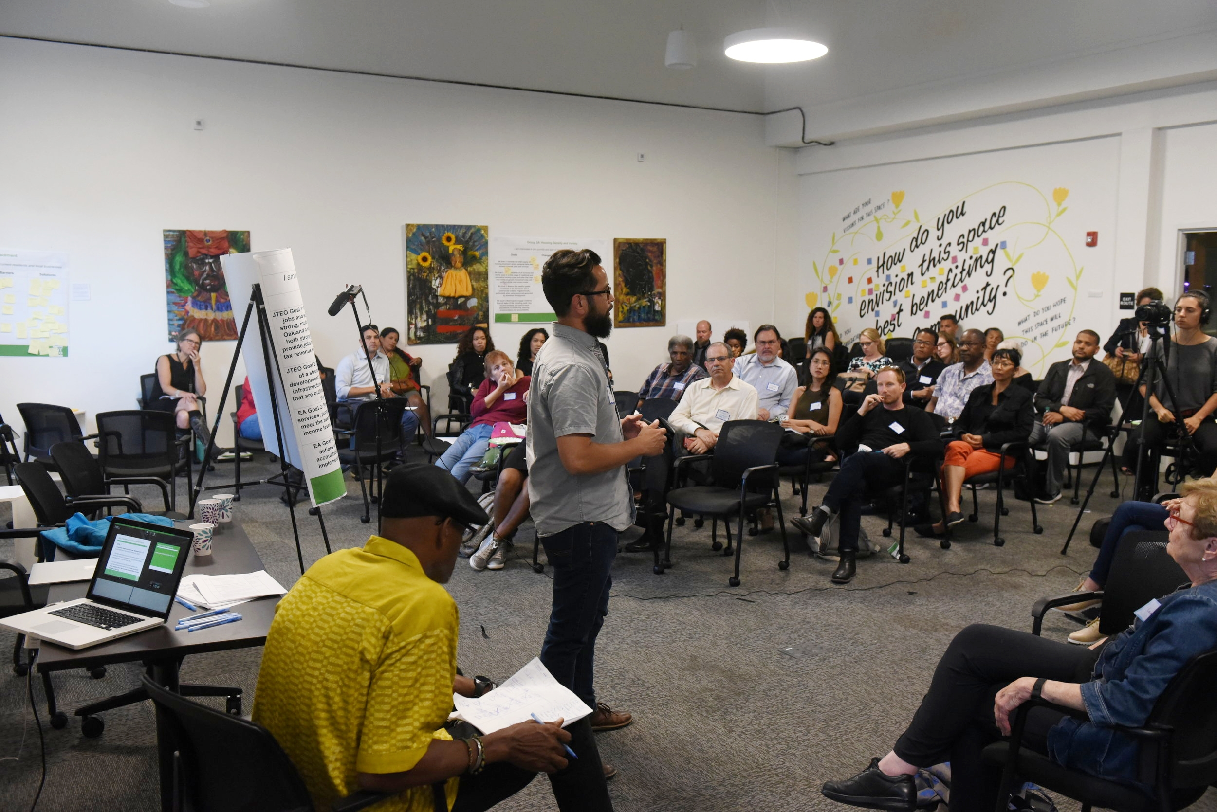 Community report-back after the small group activity where participants reflected and shared their thoughts about the changes, barriers and solutions on the draft goals for the Downtown Oakland Specific Plan.