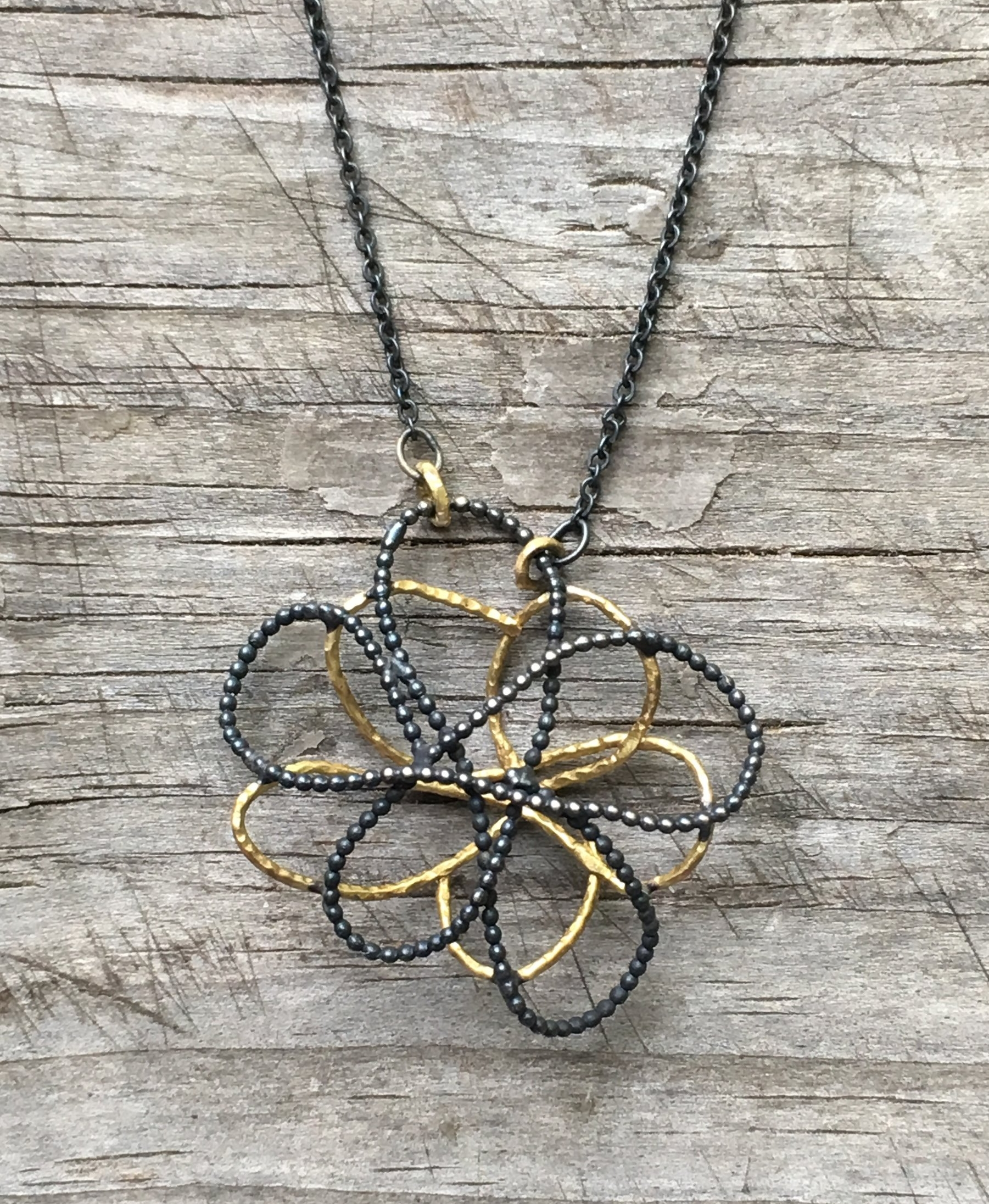 Flower sketch in 18k yg and oxidized silver necklace