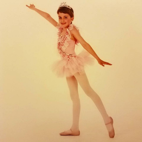 One of my first recital costumes, late 1980s. The photographer kept moving my limbs into place for me. This is me concealing the strain quite well.