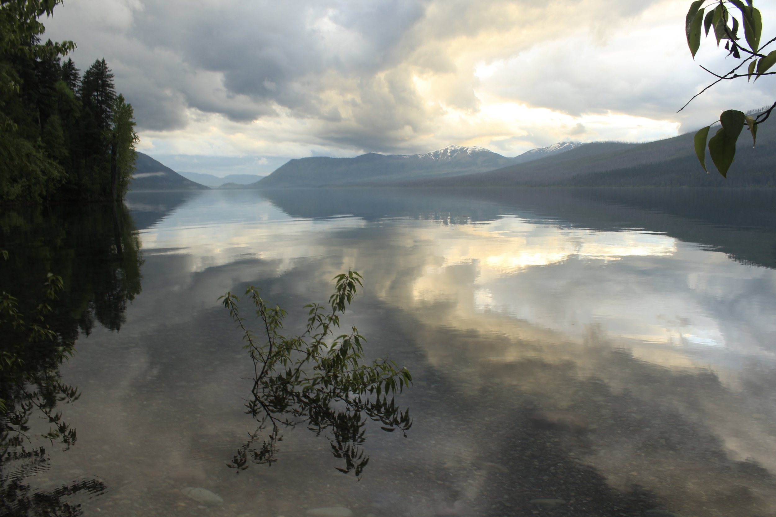 Paddle across the mirror-like Lake McDonald