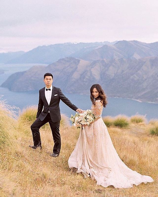 "REPOST: ""The magic that is New Zealand at sunrise✨. See it today on @magnoliarouge with amazing @jannabrowndesign florals, @leegrebenau gown from @spinabride , @theprettyparlour gorgeous MUAH and @silkandwillow with @atkins.pro.lab scans. #featured #newzealand #nz #nzelopement #newzealandelopement #nzwedding #nzweddingphotographer #newzealandwedding #elopement #elopementphotographer #destinationwedding #destinationweddingphotographer #destinationphotographer #destinationprewedding #mountaintop #mountainelopement #wanaka #lakewanaka #wanakawedding #wanakaweddingphotographer #queenstownwedding #couture #bouquet #queenstownweddingphotographer #royspeak : @katiegrantphoto """