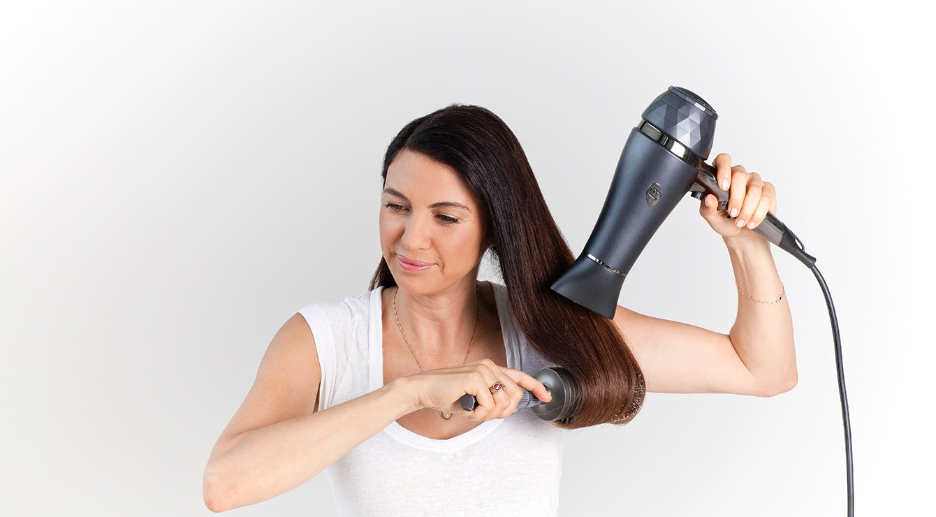 STEP 1 - Rough dry hair to 90% using the PROi with the wide concentrator, then finish drying to 100% using your preferred Anti-Gravity Barrel Brush to smooth hair out.