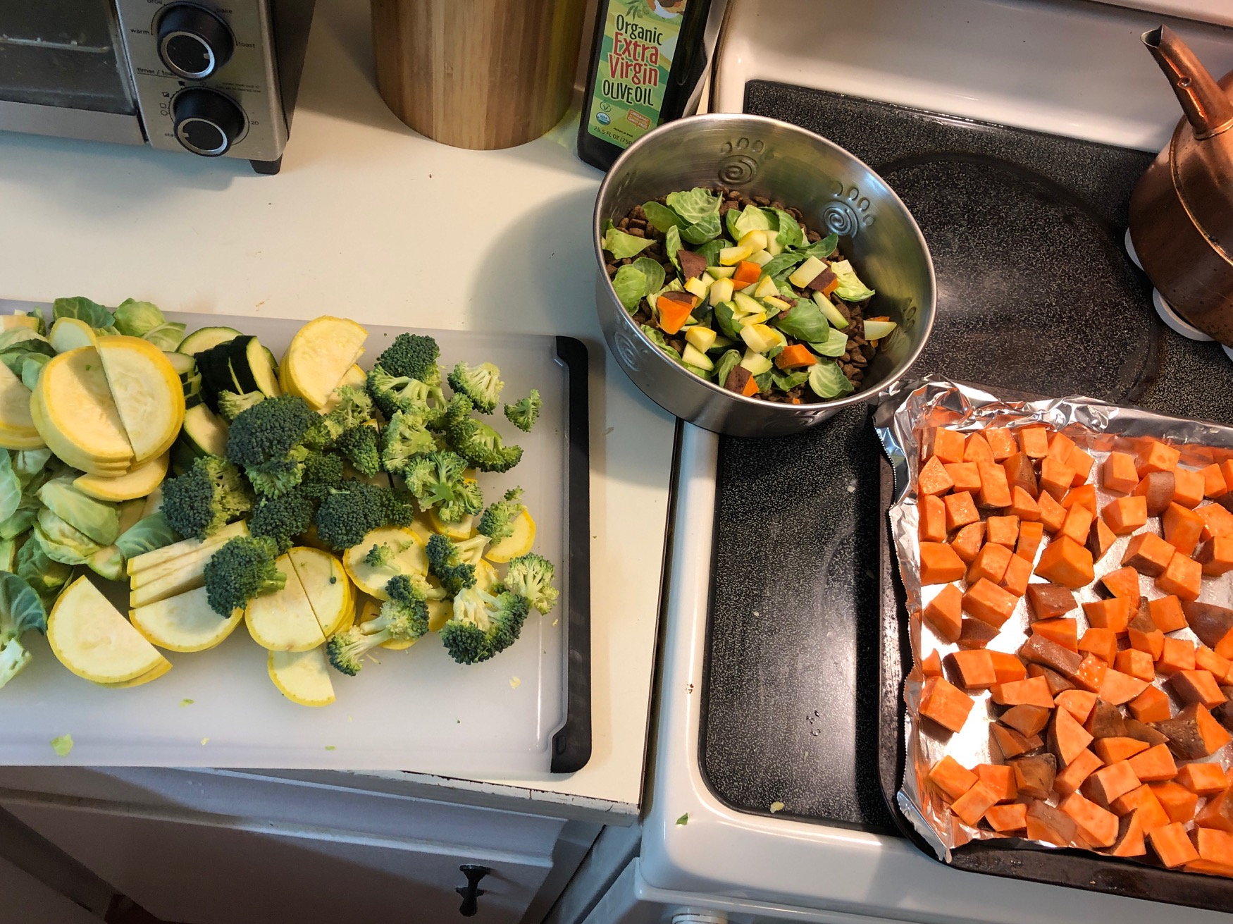 Cutting up veggies to roast and then Stella gets some of the veggies scraps for her dinner on Sunday too! She LOVES them all.