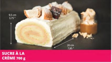Pâte vanille garnie de sucre à la crème 35%, recouverte de mousseline vanille et d'éclats de profiteroles à la crème.  Allergènes: Blé (gluten), lait, soya, oeuf. Peut contenir des noix et/ou des arachides.