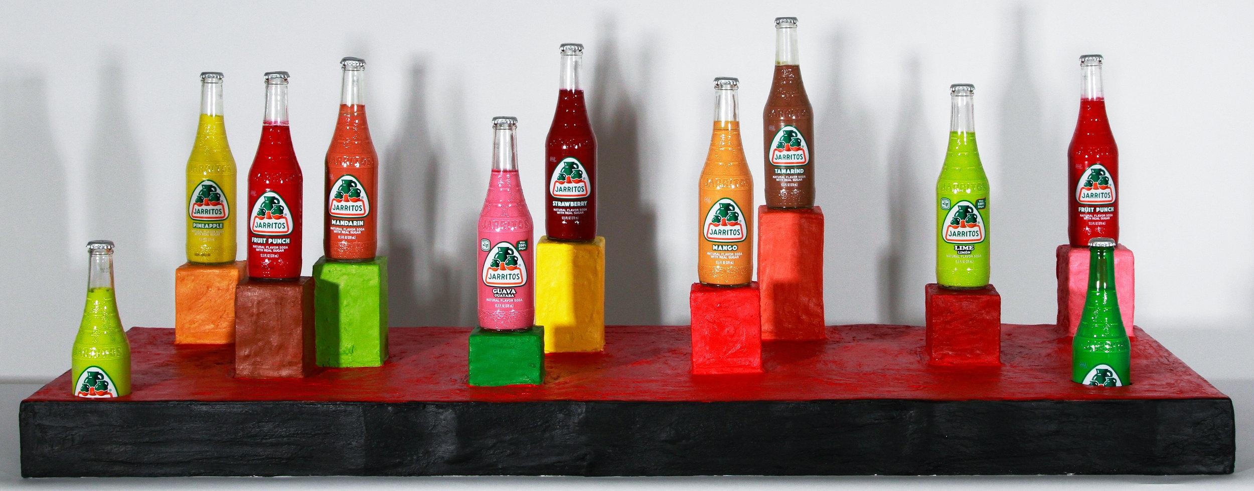 Ciudad de inmigrantes   tempera in Jarritos glass bottles, acrylic on plaster on chipboard