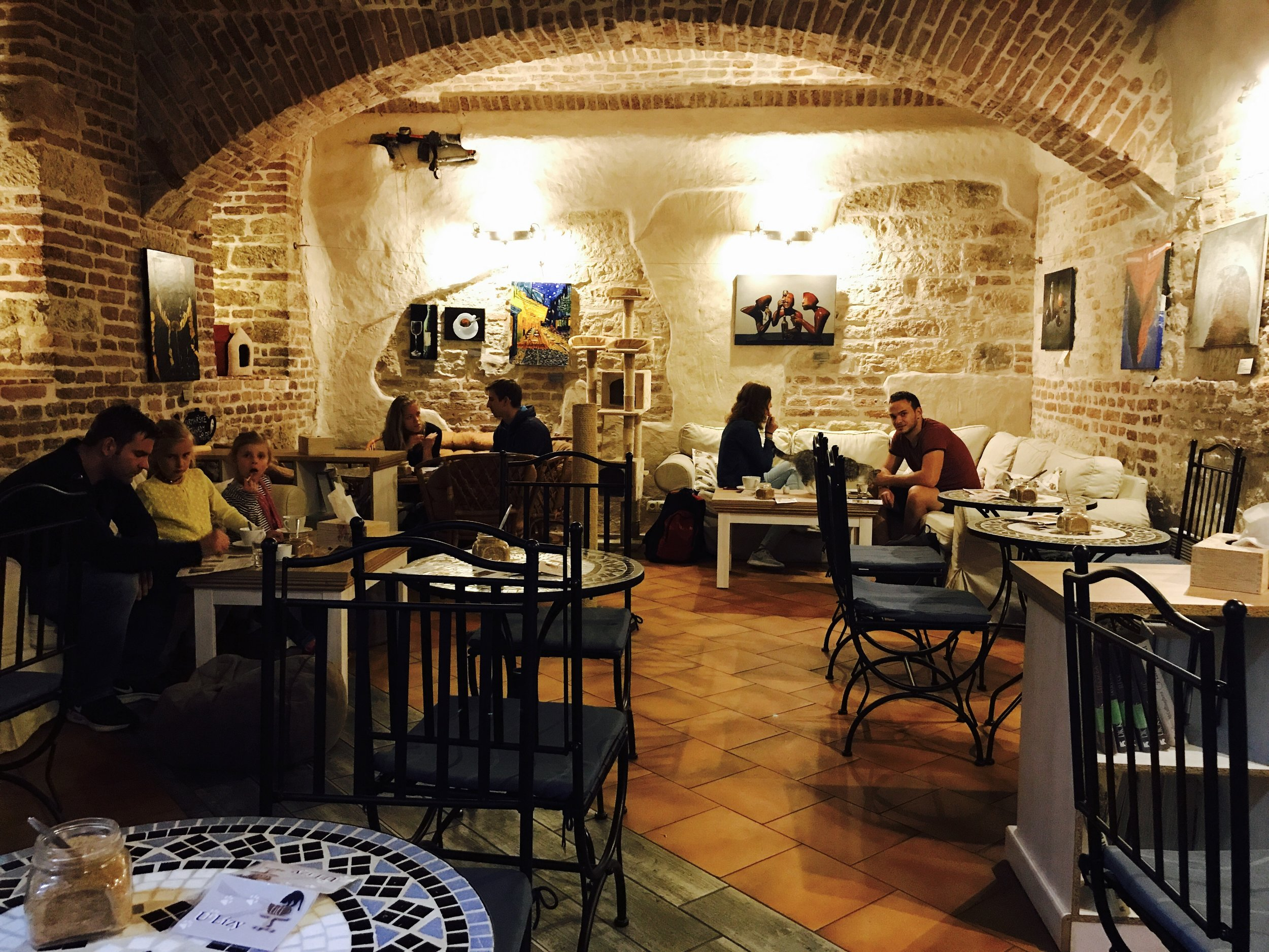 Kavarna Kocici has two levels, including a basement with cozy seating
