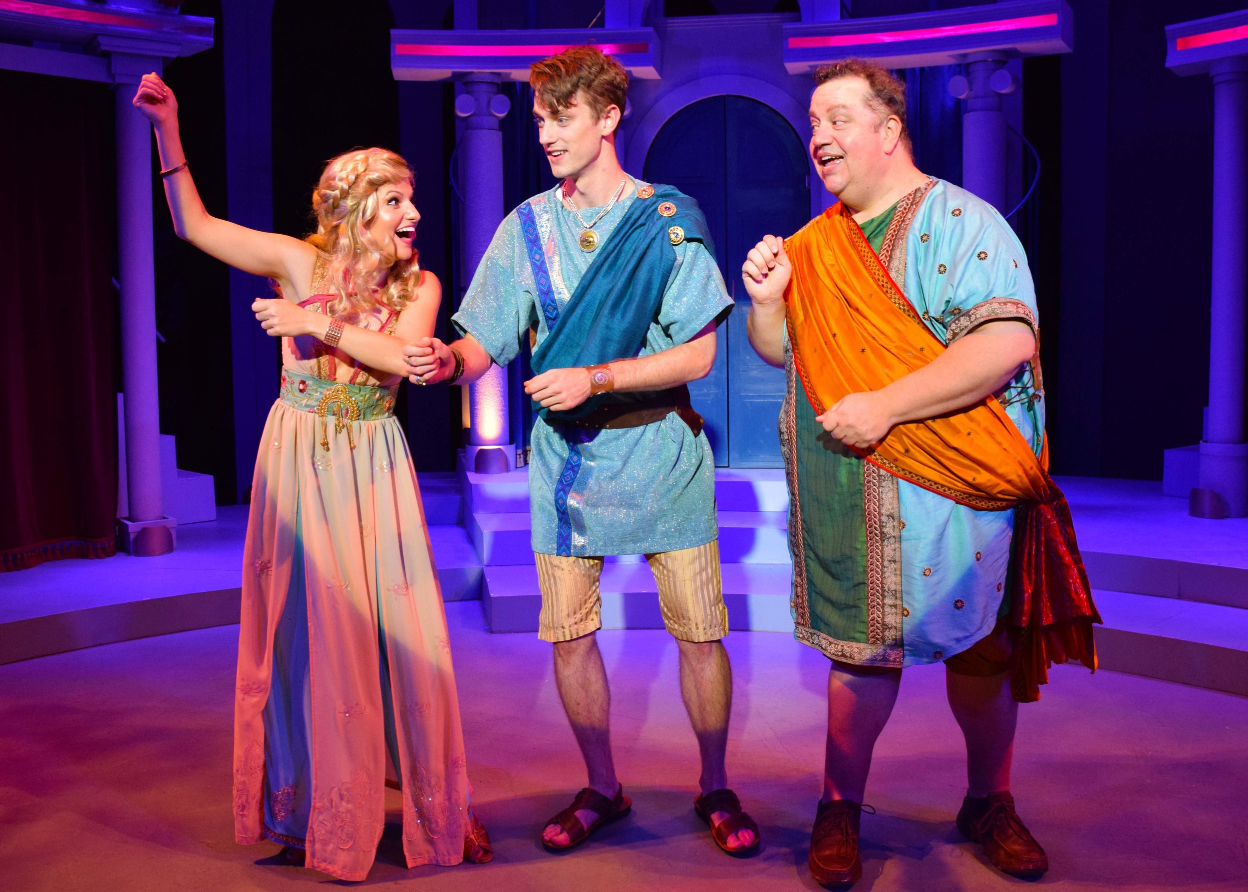 Philia (Nicole Kaplan), Hero (Michael Thomas Grant), Pseudolus (Paul C. Vogt) in A Funny Thing Happened On The Way To The Forum at the Garry Marshall Theatre. Photo by Chelsea Sutton.