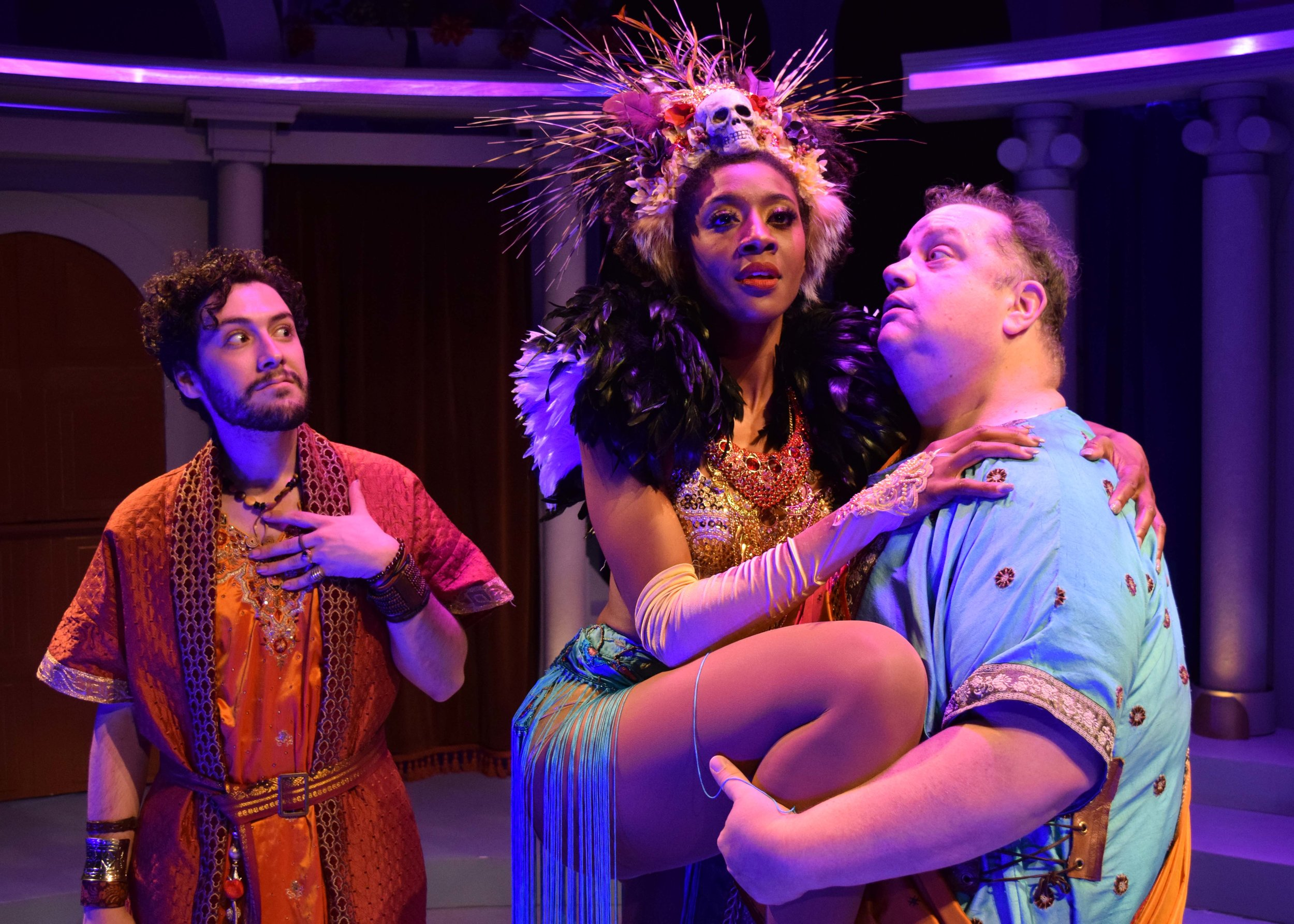 Lycus (E.K. Dagenfield), Gymnasia (Shamicka Benn) and Pseudolus (Paul C. Vogt) in A Funny Thing Happened On The Way To The Forum at the Garry Marshall Theatre. Photo by Chelsea Sutton.