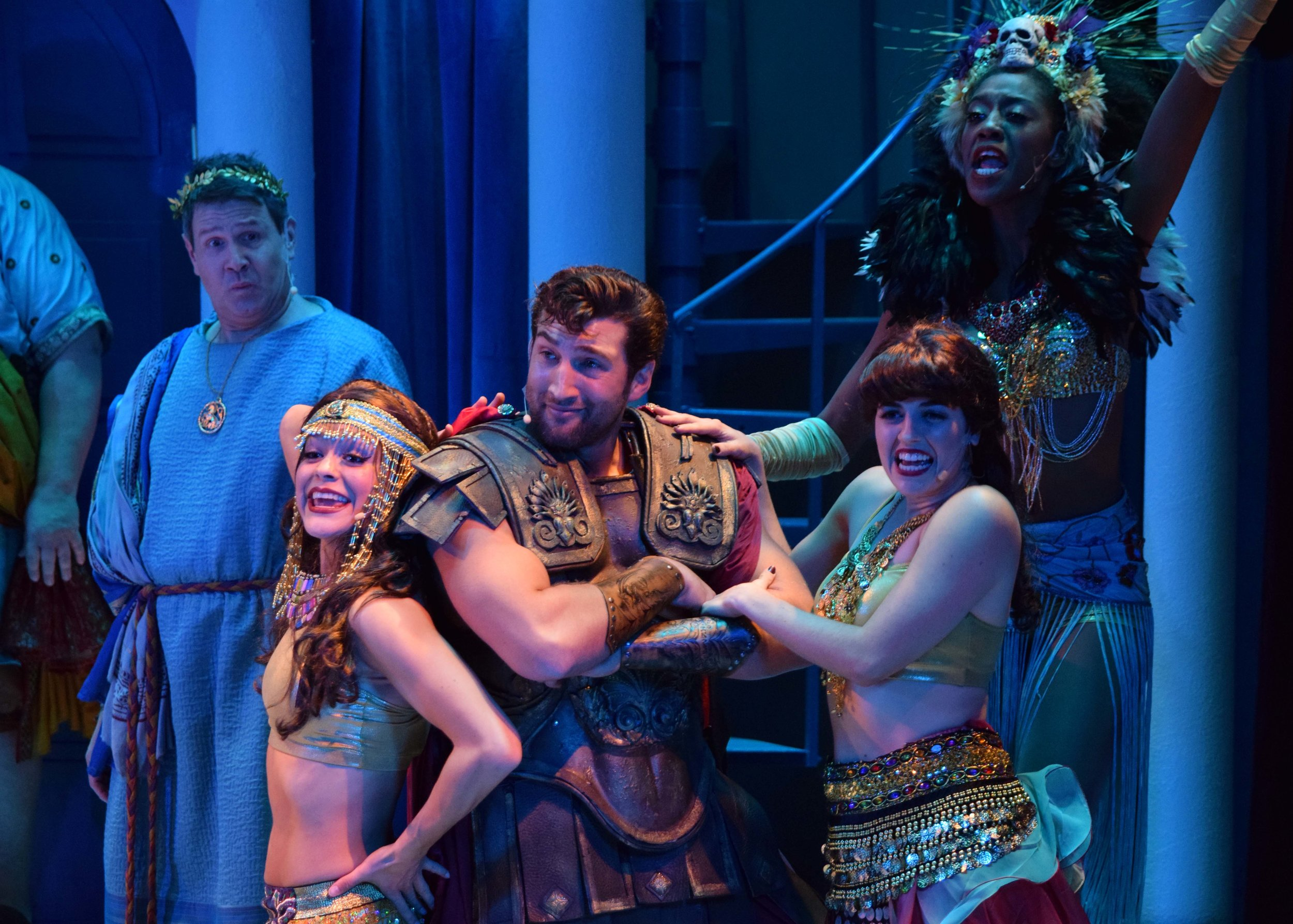 Senex (Kevin Symons) and Miles Glorious (Clayton Snyder) with Courtesans (Liz Bustle, Shamicka Benn, and Vanessa Nichole) in A Funny Thing Happened On The Way To The Forum at the Garry Marshall Theatre. Photo by Chelsea Sutton.