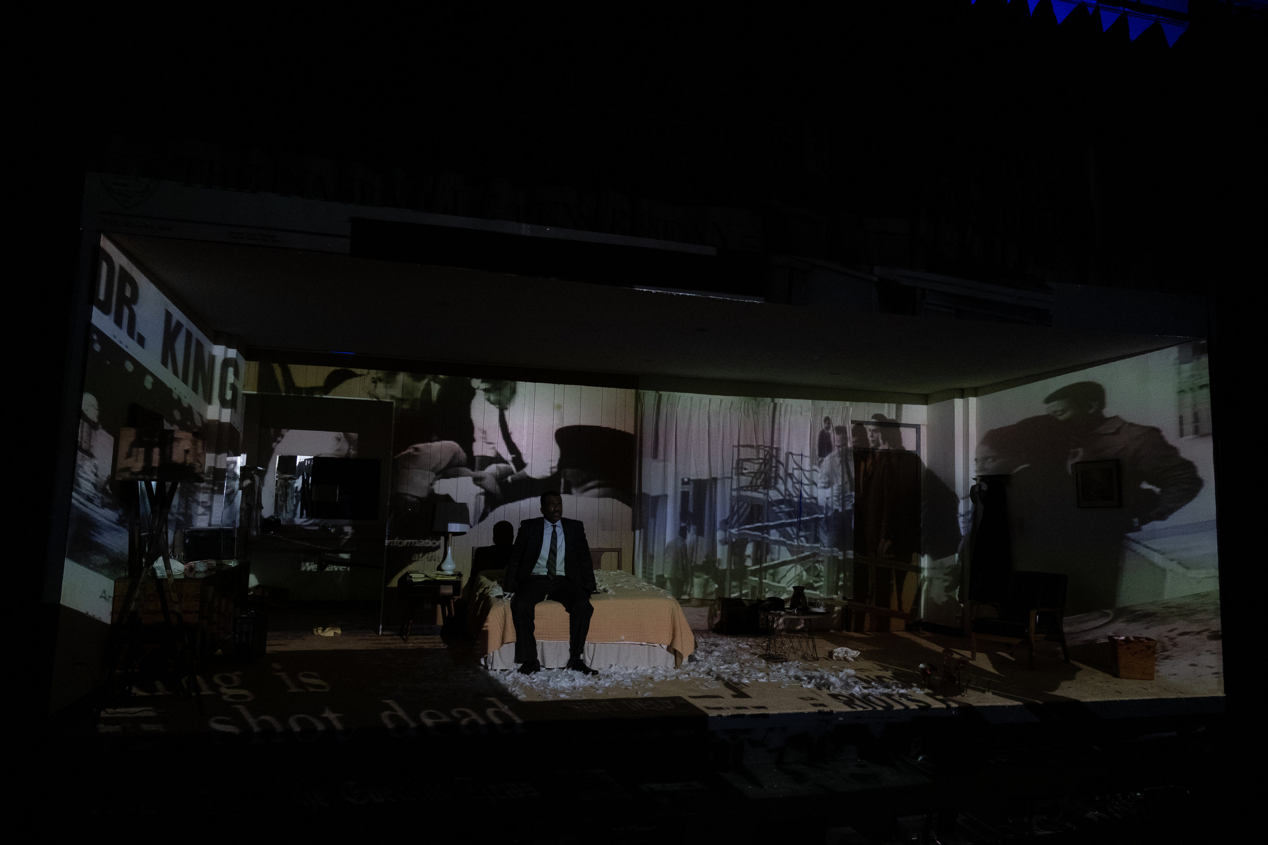 THE MOUNTAINTOP by Katori Hall. Scenic Design by ALEX CALLE. Lighting Design by JM MONTECALVO. Sound Design by ROBERT A. RAMIREZ. Props by JOHN M. McELVENEY. Projection Design by: YEE EUN NAM. Costume Design by WENDELL CARMICHAEL.  GILBERT GLENN BROWN as Dr Martin Luther King Jr