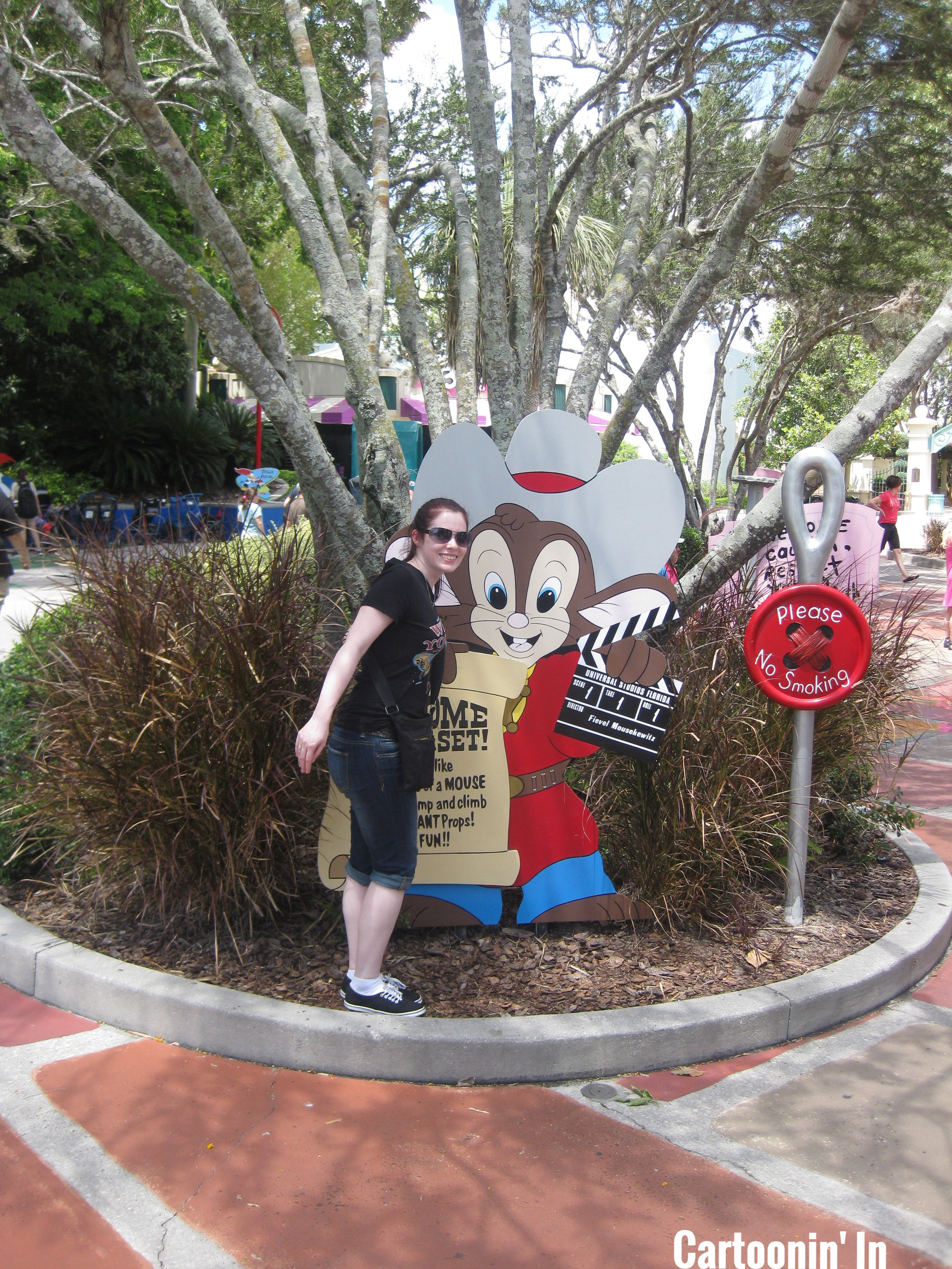 Aly (at the height of fashion here) posing next to the Feivel sign at Universal Studios Orlando