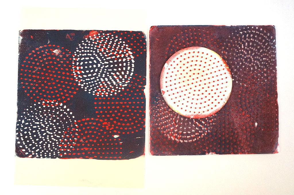 a plain with a single hama bead tile pressed into it was printed in red, then more marks were added with the bead board and the tile printed over the top in navy blue.
