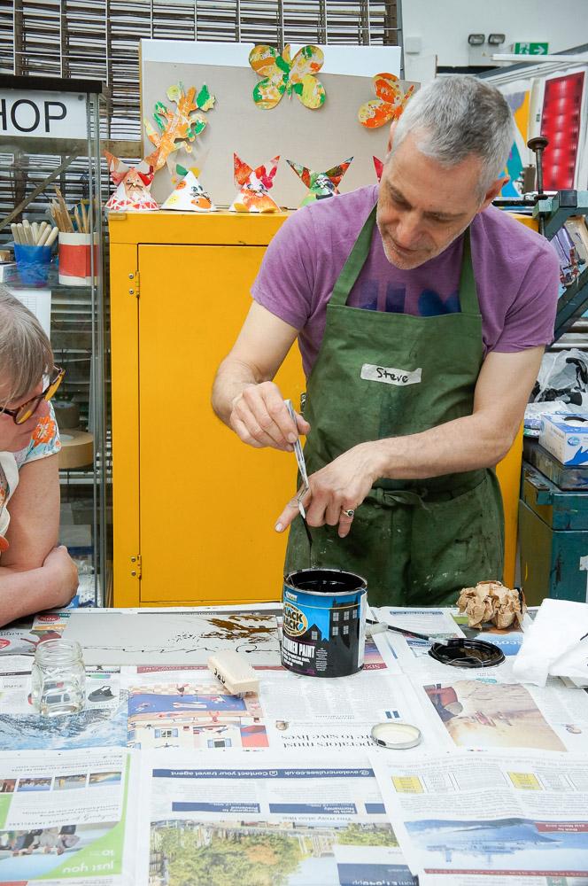 Steve demonstrating applying bitumen paint resist