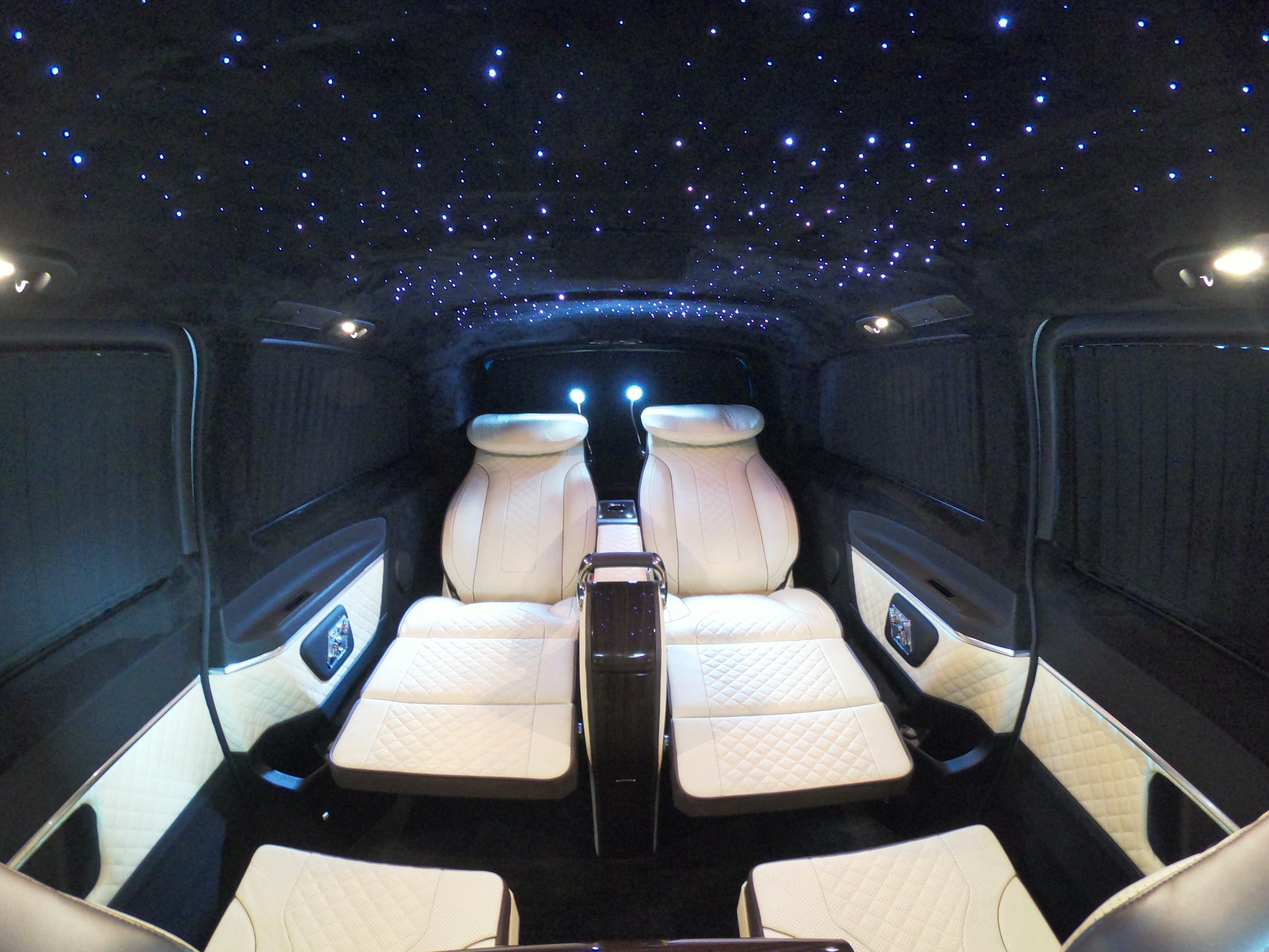 An LED colour changing star light roof inside the Monaco V-Class.