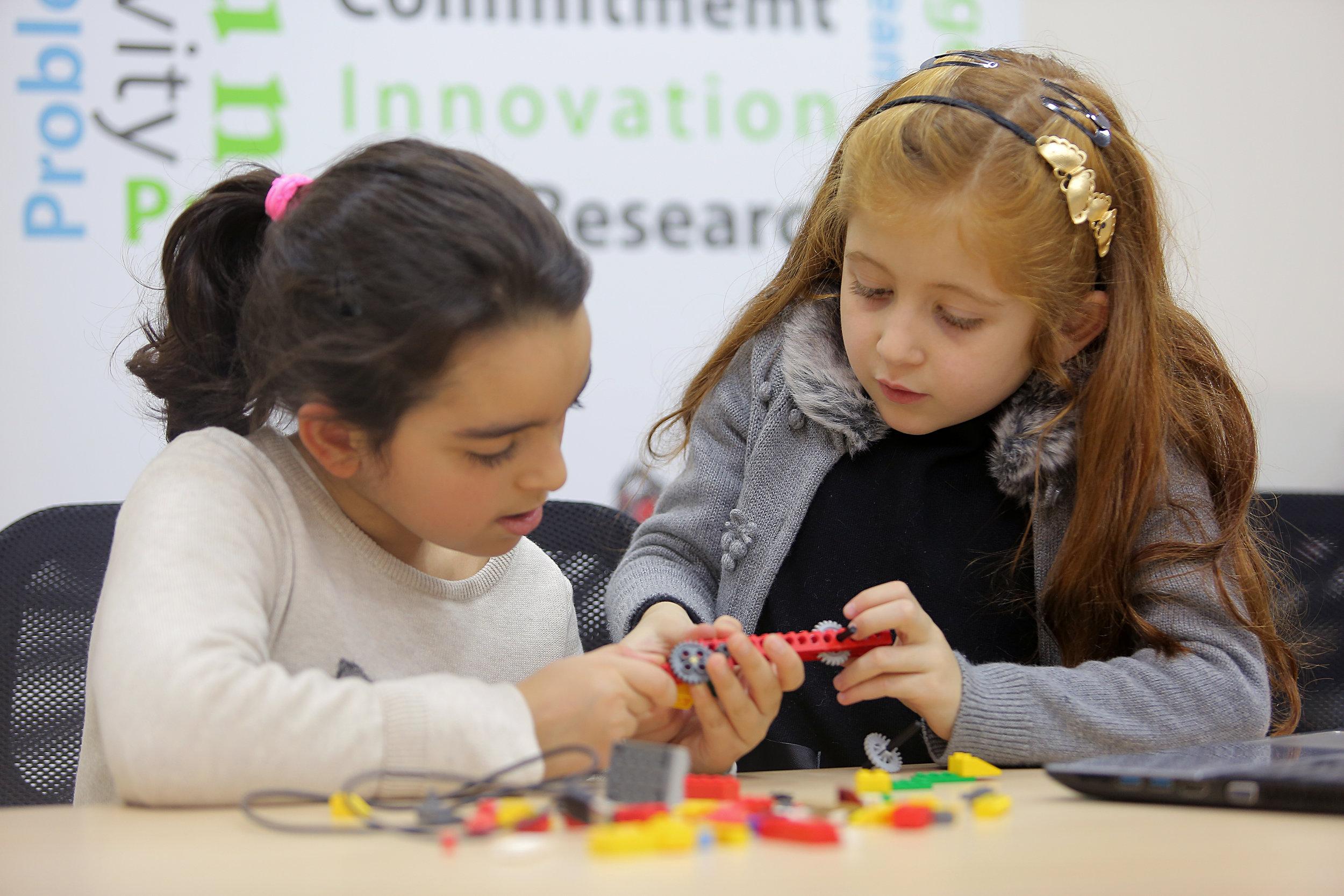 Sumaya & Mariam constructing a crane during a WeDo course