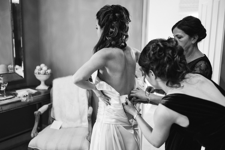 Granary Estates wedding photo - bride getting in her wedding dress