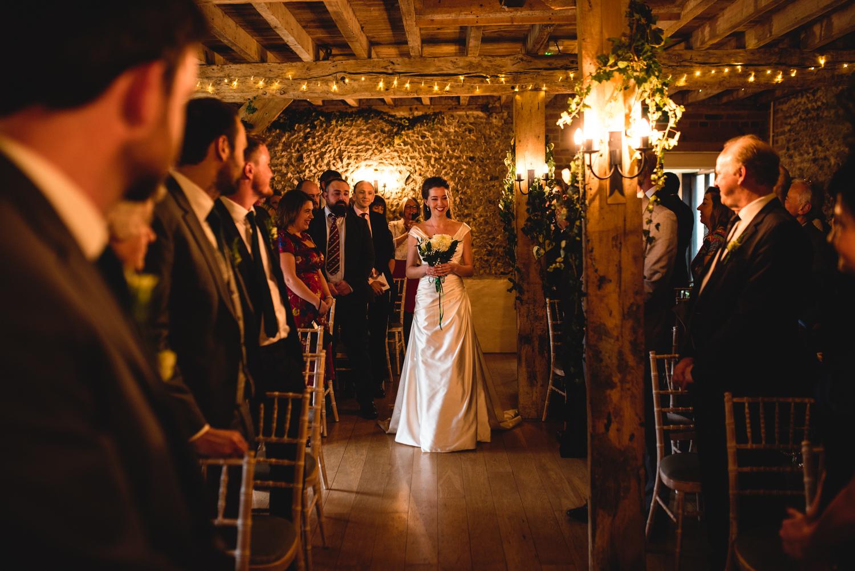 Granary Estates wedding photo - bride walking down the aisle