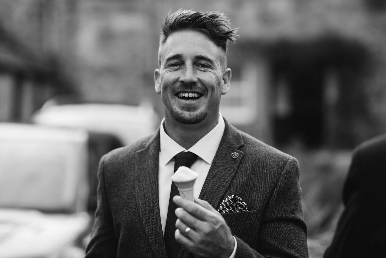Newhall Estate Edinburgh Wedding - groom eating irn bru sorbet
