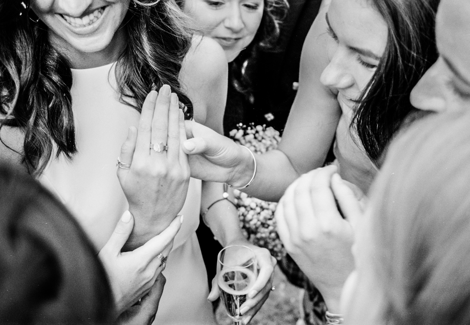 Newhall Estate Edinburgh Wedding - bride shows her ring to guests