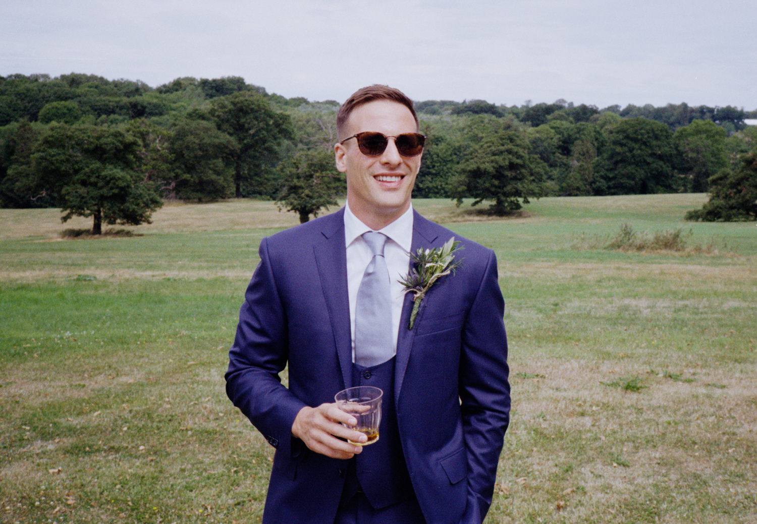 Photographing with film at weddings - a groom with whisky