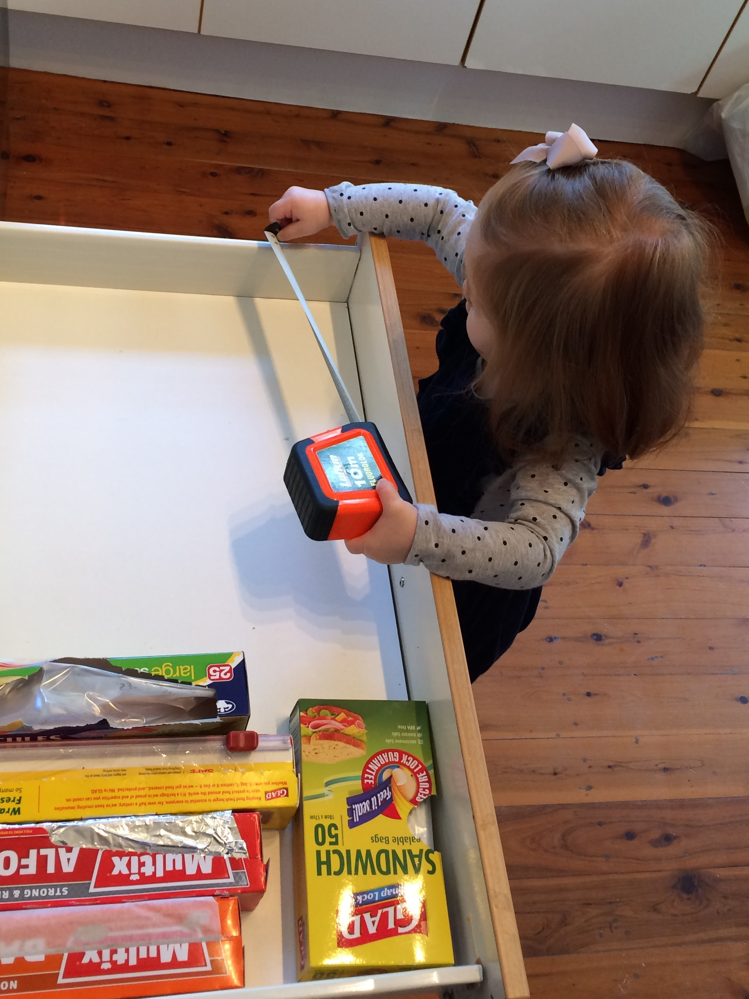 OUR LITTLE ONE MEASURING UP THAT KITCHEN - SHE IS READY TO GET THIS STARTED!!