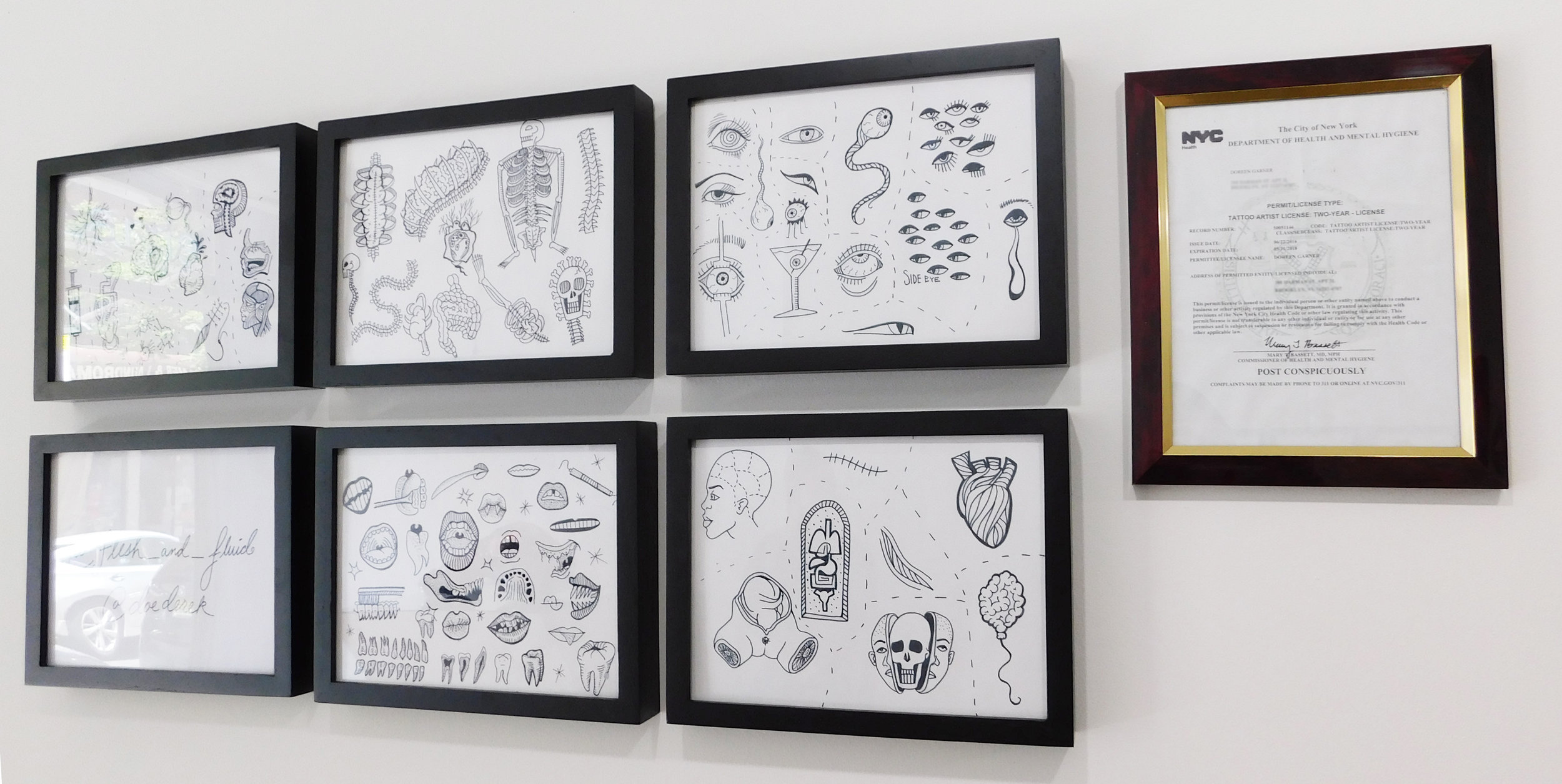 Doreen Garner's flash art for tattooing, and her tattoo artist license. Photo by the author.