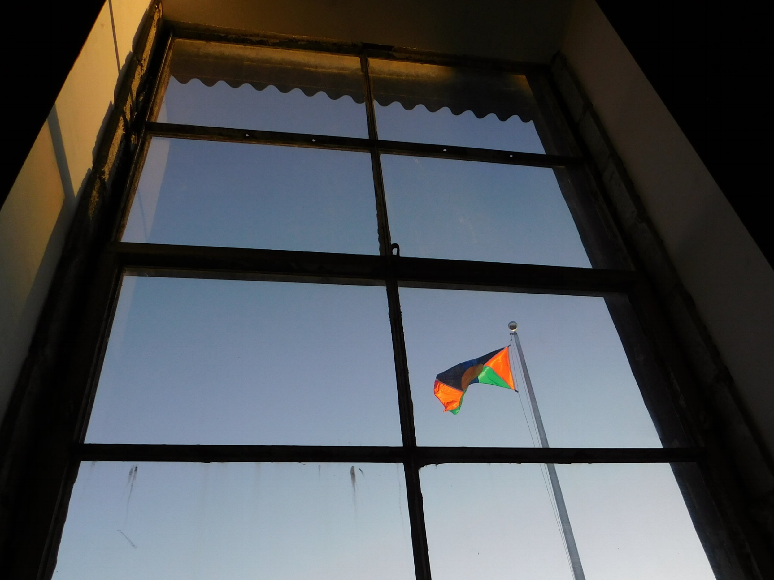 The New Davonhaime flag that Mohammed created for the flagpole outside of the Knockdown Center, as viewed from within his exhibition. Photo by the author.