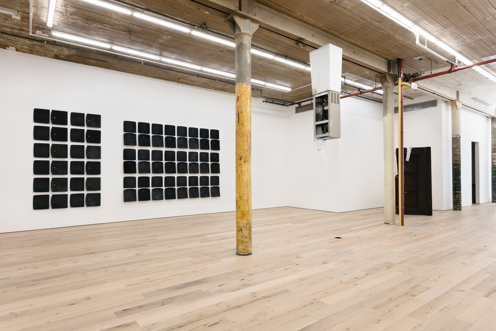 """Installation view of the group exhibition  """"Invisible Man""""  at Martos Gallery, New York, NY, May 3 through June 24, 2017, with Jessica Vaughn's   After Willis (rubbed, used and moved) #005   (2017) visible on the left"""