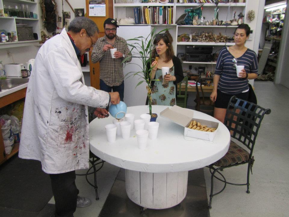 Whitten pouring tea for the students
