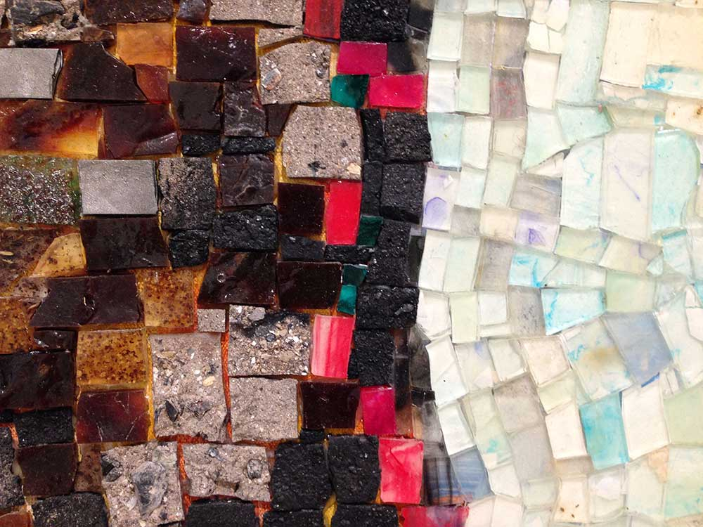 Detail of one of Jack Whitten's acrylic mosaic paintings that includes molasses, copper, salt, coal, ash, chocolate, onion, herbs, rust, and eggshell