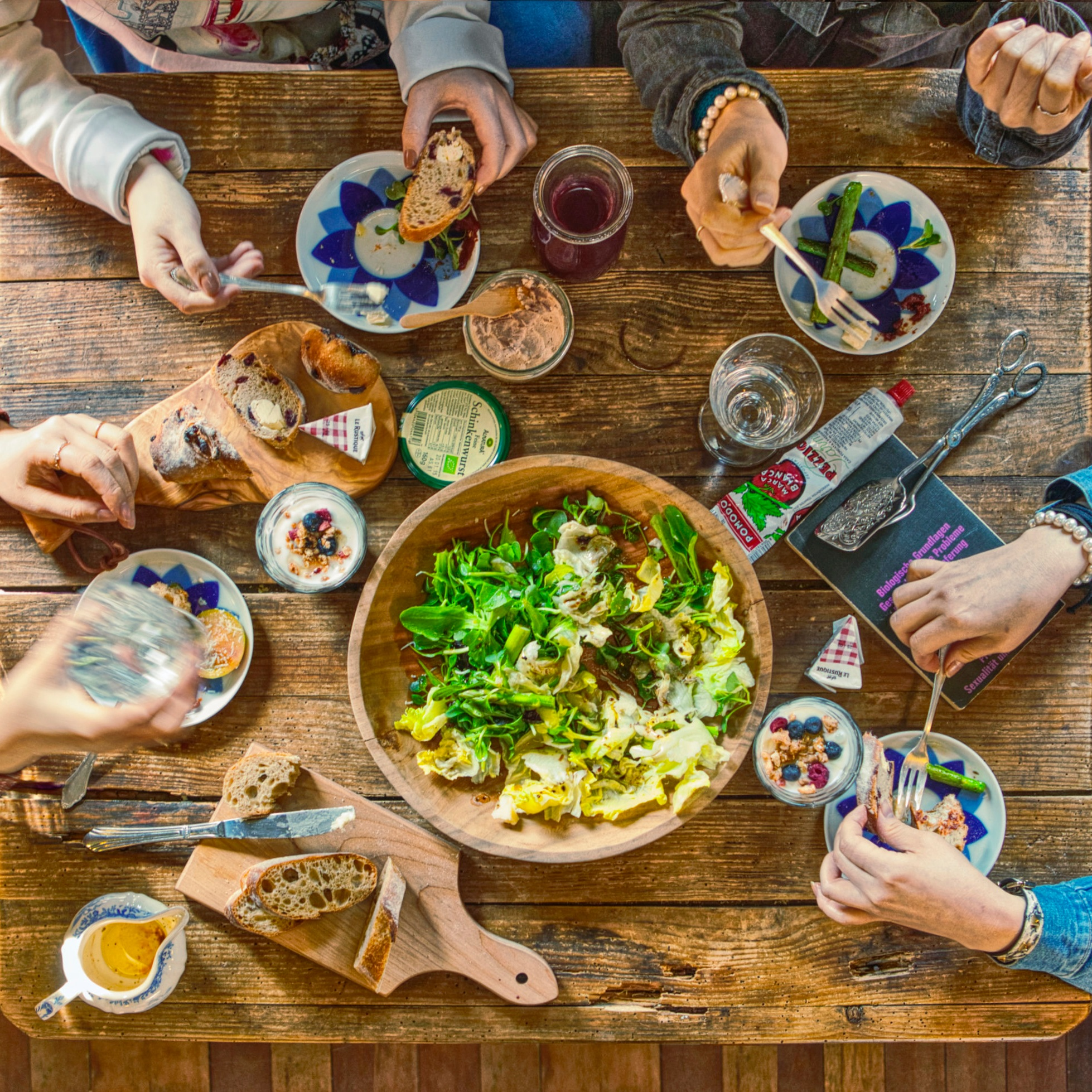 people gathered around food at a table