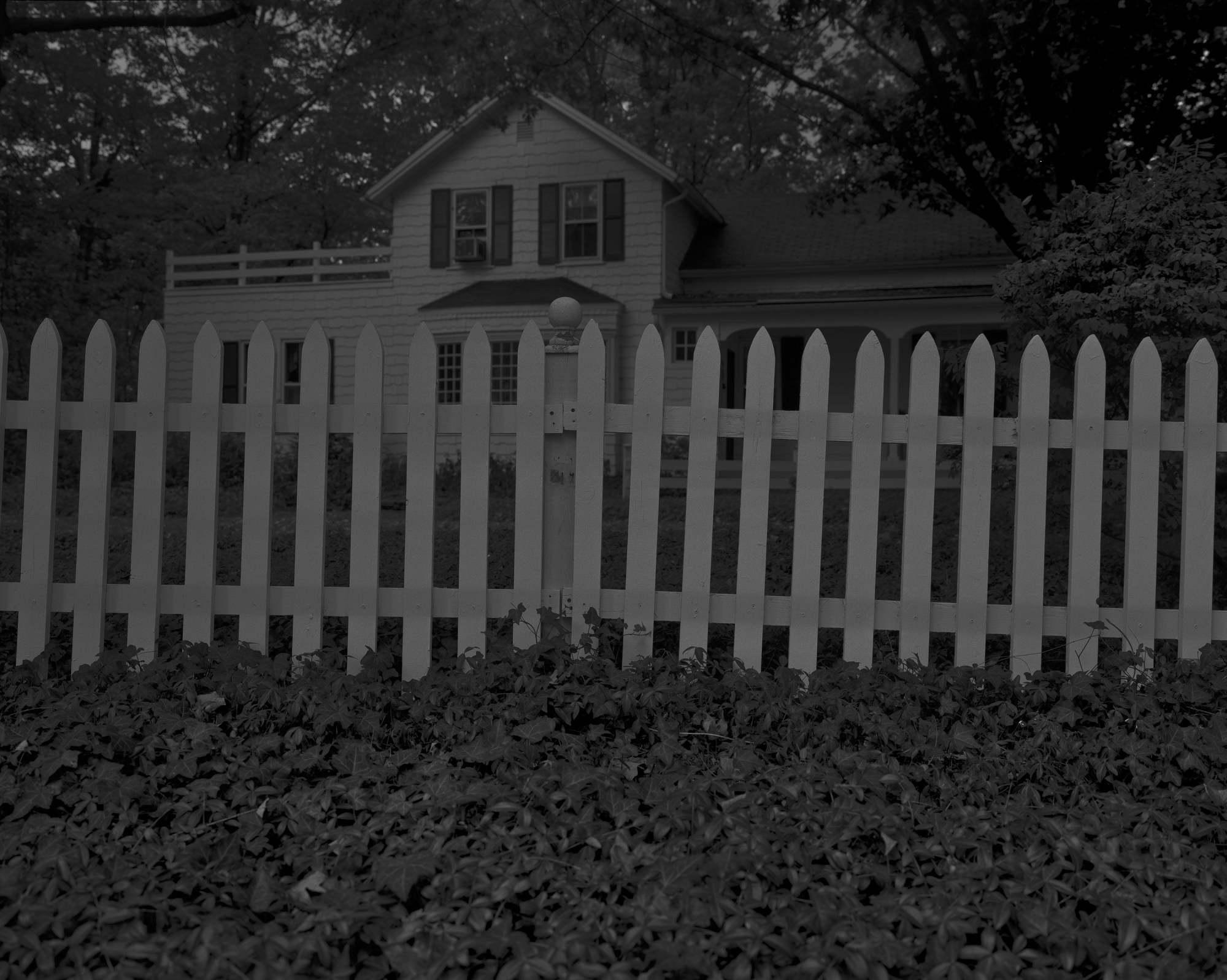 "Dawoud Bey,  Untitled #1 (Picket Fence and Farmhouse),"" from the series ""Night Coming Tenderly, Black , 2017. Rennie Collection, Vancouver."