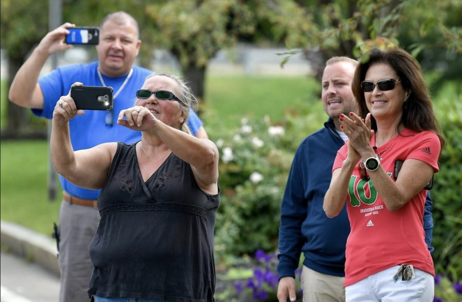 Community members capture the moment as Dave McGillivray starts his run from Medford City Hall to Fenway Park to commemorate his 40th Anniversary of running from Medford, Oregon to Medford, MA to raise money for the Jimmy Fund, on Thursday, Aug. 23, 2018. [Wicked Local Staff Photo / David Sokol]