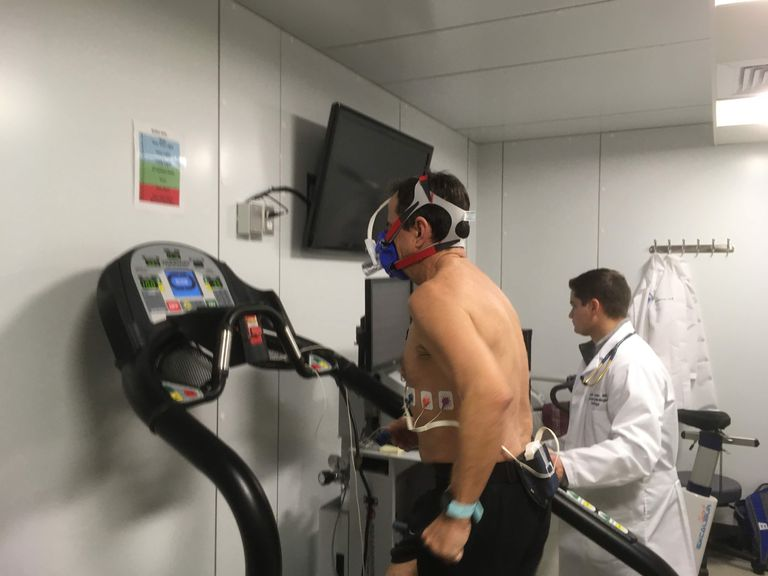 Decked out in wires monitoring his heart function, Dave McGillivray undergoes a cardio-pulmonary exercise test.