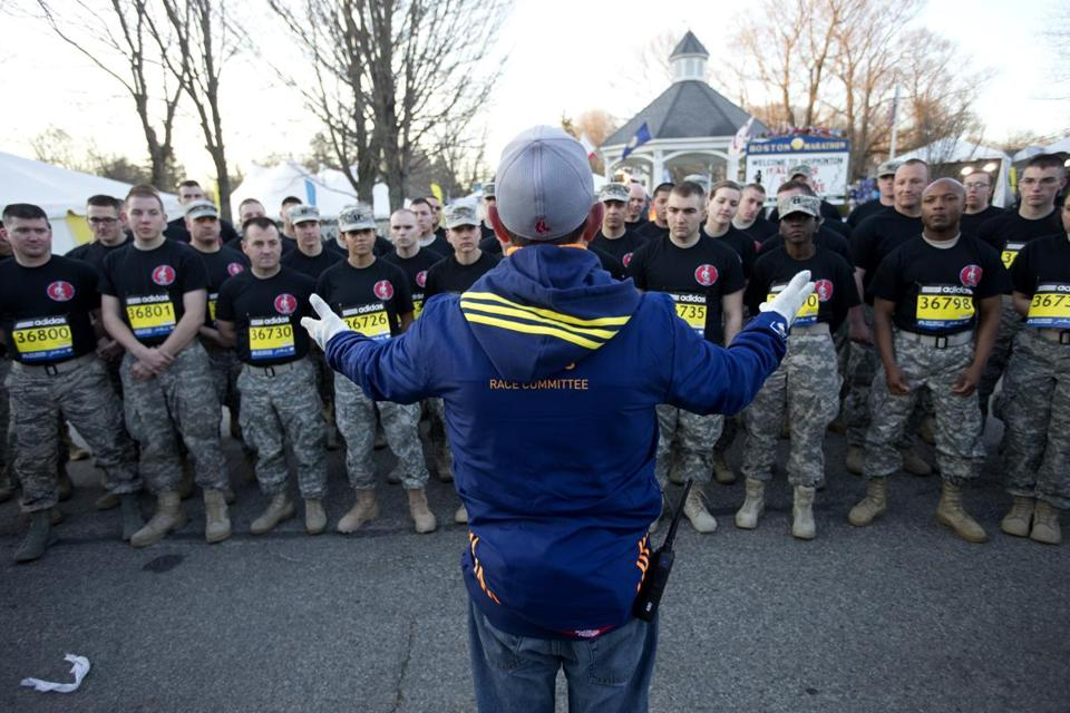 About 100 members of the Massachusetts Army and Air National Guard marched the Boston Marathon course.