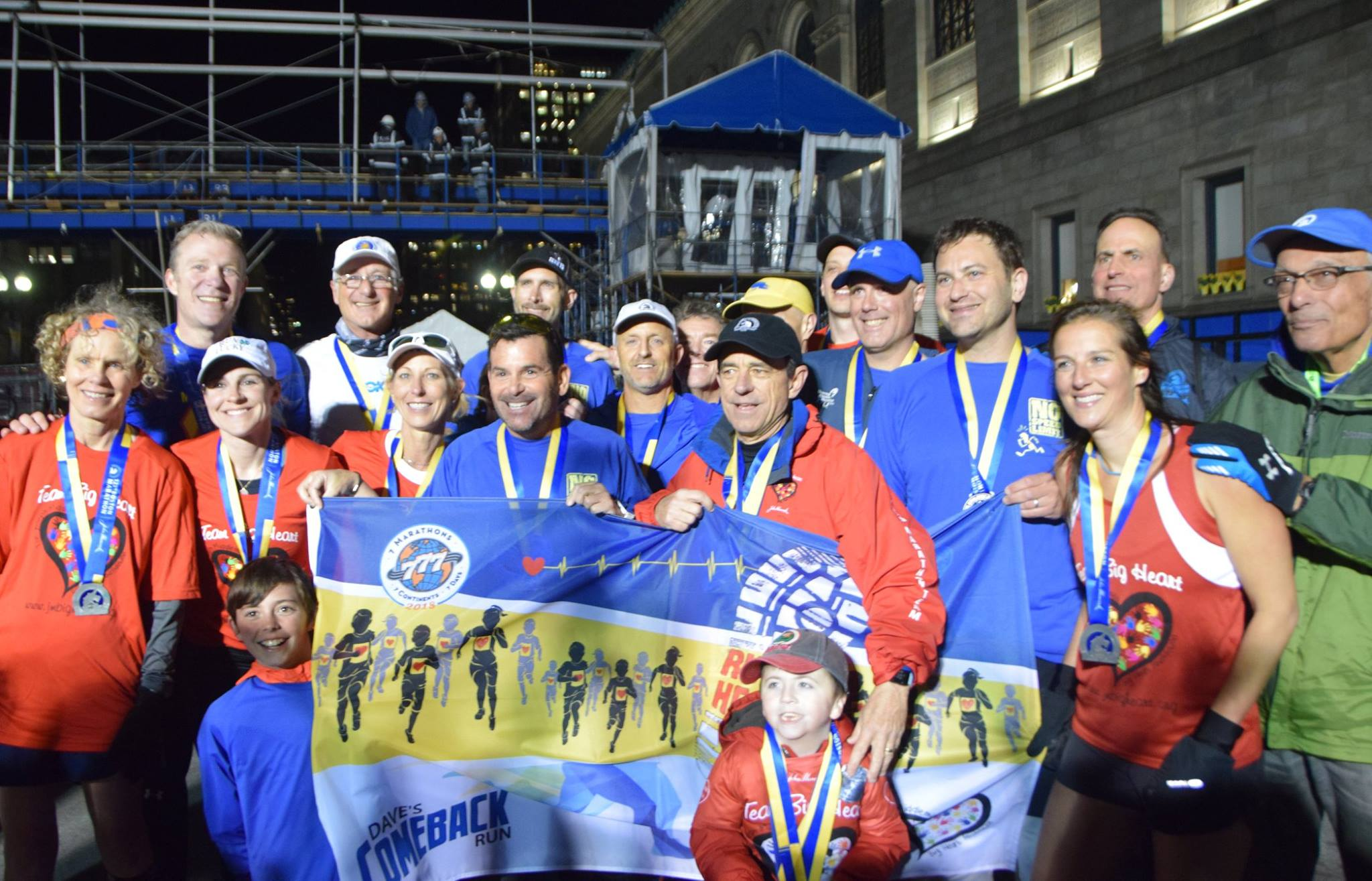 """Dave McGillivray and his team of runners pose at the finish line for the completion of his """"comeback run.""""   Bob McGillivray"""