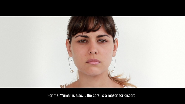Mari Claudia García    Genealogy of the Metaphor , 2016 Video-installation/action.  Video screening, postcards, wood shelf  Variable dimensions  ED. 3, 1 artist proof.