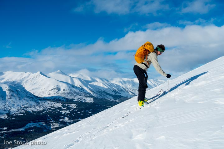 212th Pararescueman Brock Roden ski pole probes for the persistent slab. Kenai Mountains.